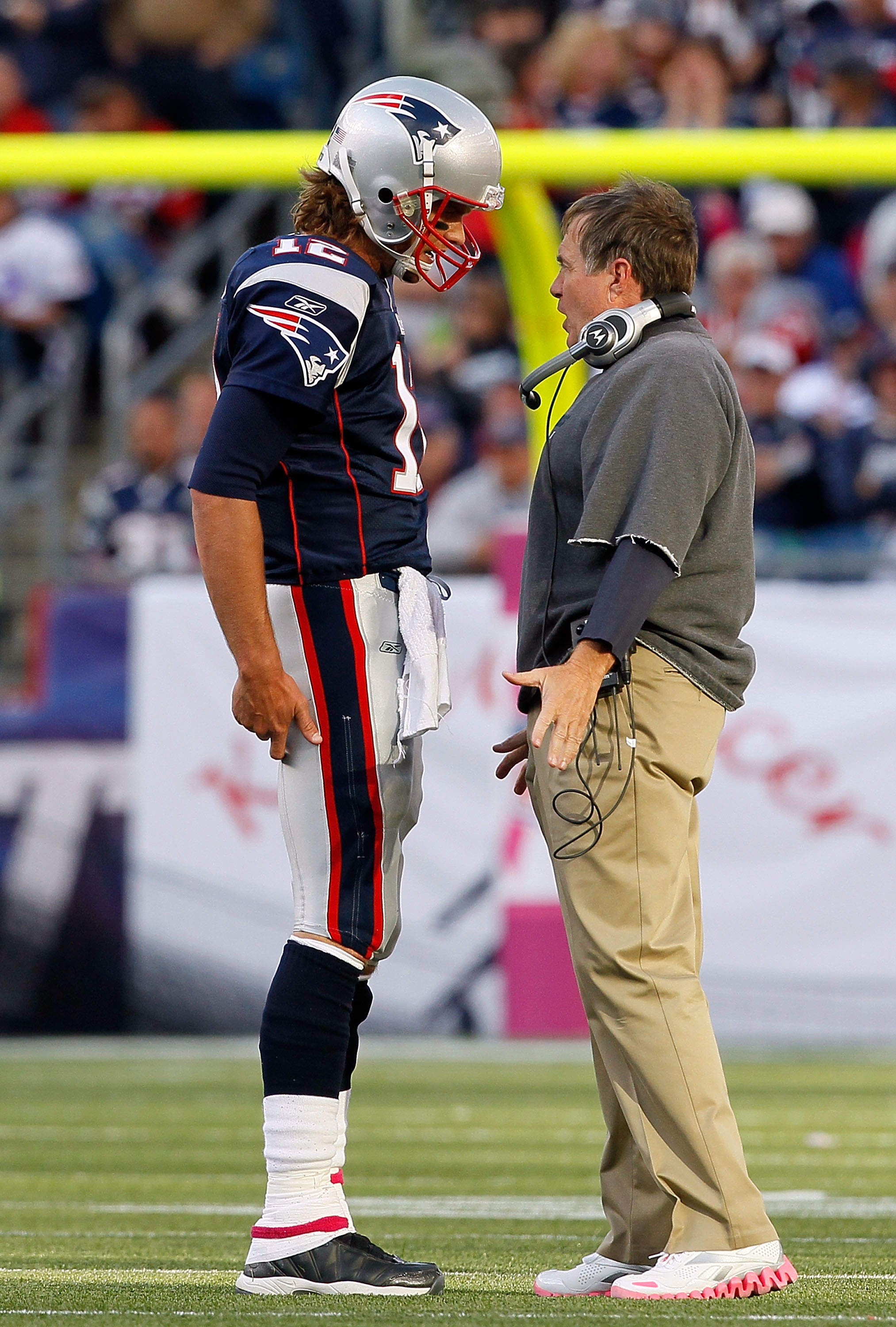 FOXBORO, MA - OCTOBER 17:  Coach Bill Belichick of the New England Patriots talks to his quarterback Tom Brady during a game against the Baltimore Ravens at Gillette Stadium on October 17, 2010 in Foxboro, Massachusetts. (Photo by Jim Rogash/Getty Images)
