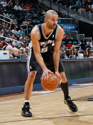 ATLANTA, GA - APRIL 05:  Tony Parker #9 of the San Antonio Spurs against the Atlanta Hawks at Philips Arena on April 5, 2011 in Atlanta, Georgia.  NOTE TO USER: User expressly acknowledges and agrees that, by downloading and/or using this Photograph, user