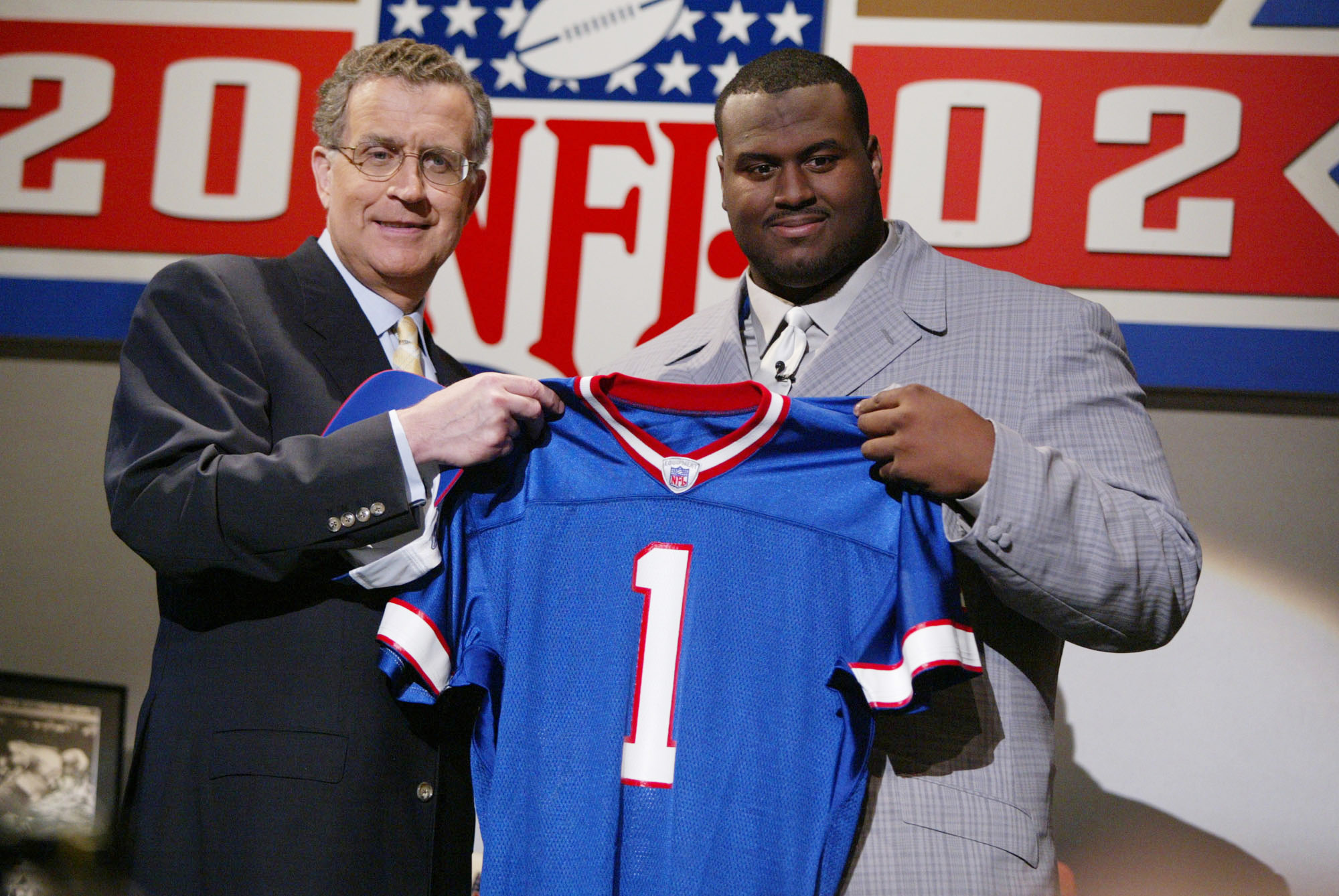 20 April 2002:  Mike Williams of Texas stands with NFL Commisioner Paul Tagliabue after being the fourth player selected in the 2002 NFL draft at the Theatre in Madison Square Garden in New York City, New York.   Digital Image.  Mandatory Credit: Al Bello
