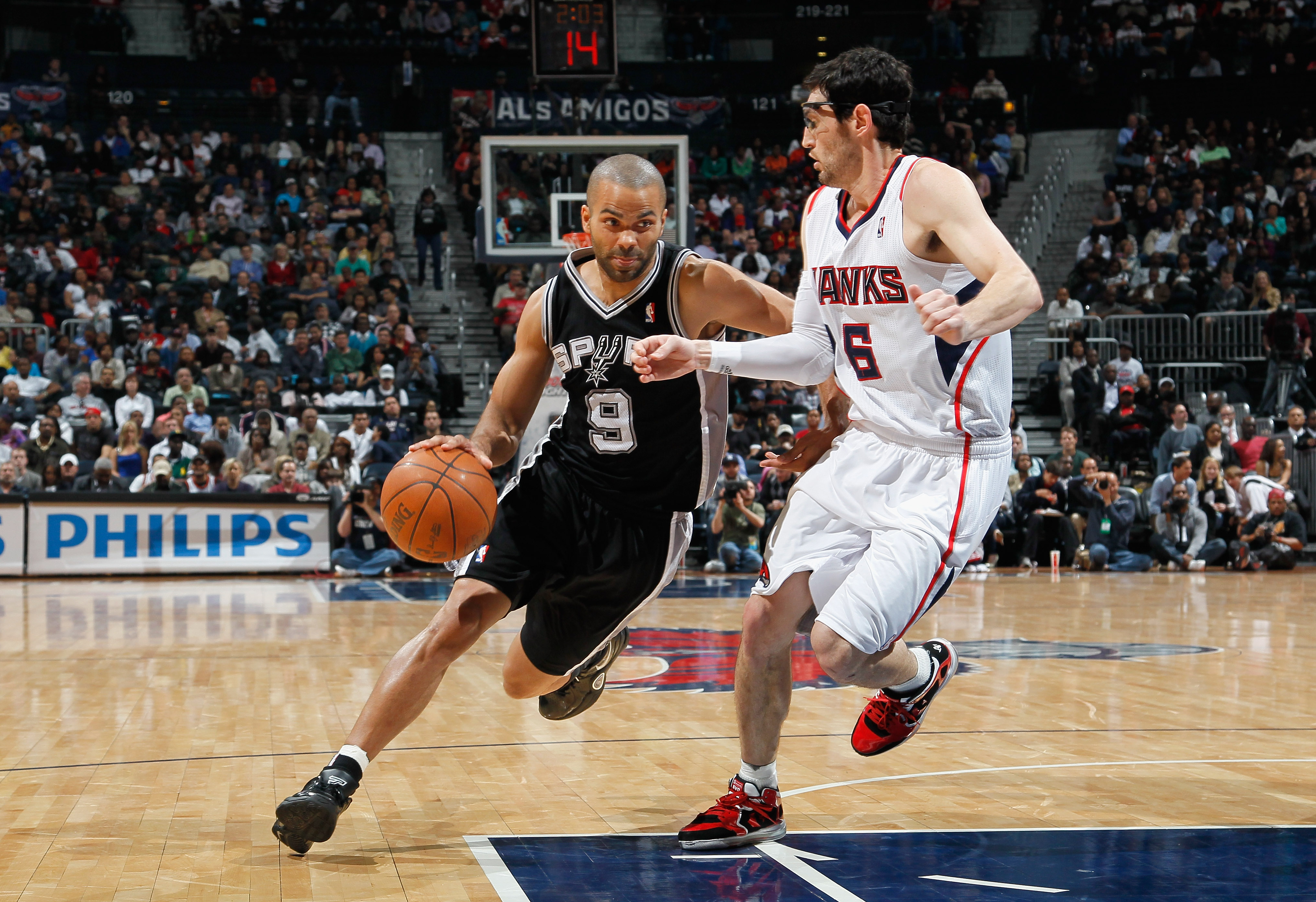 ATLANTA, GA - APRIL 05:  Tony Parker #9 of the San Antonio Spurs against Kirk Hinrich #6 of the Atlanta Hawks at Philips Arena on April 5, 2011 in Atlanta, Georgia.  NOTE TO USER: User expressly acknowledges and agrees that, by downloading and/or using th