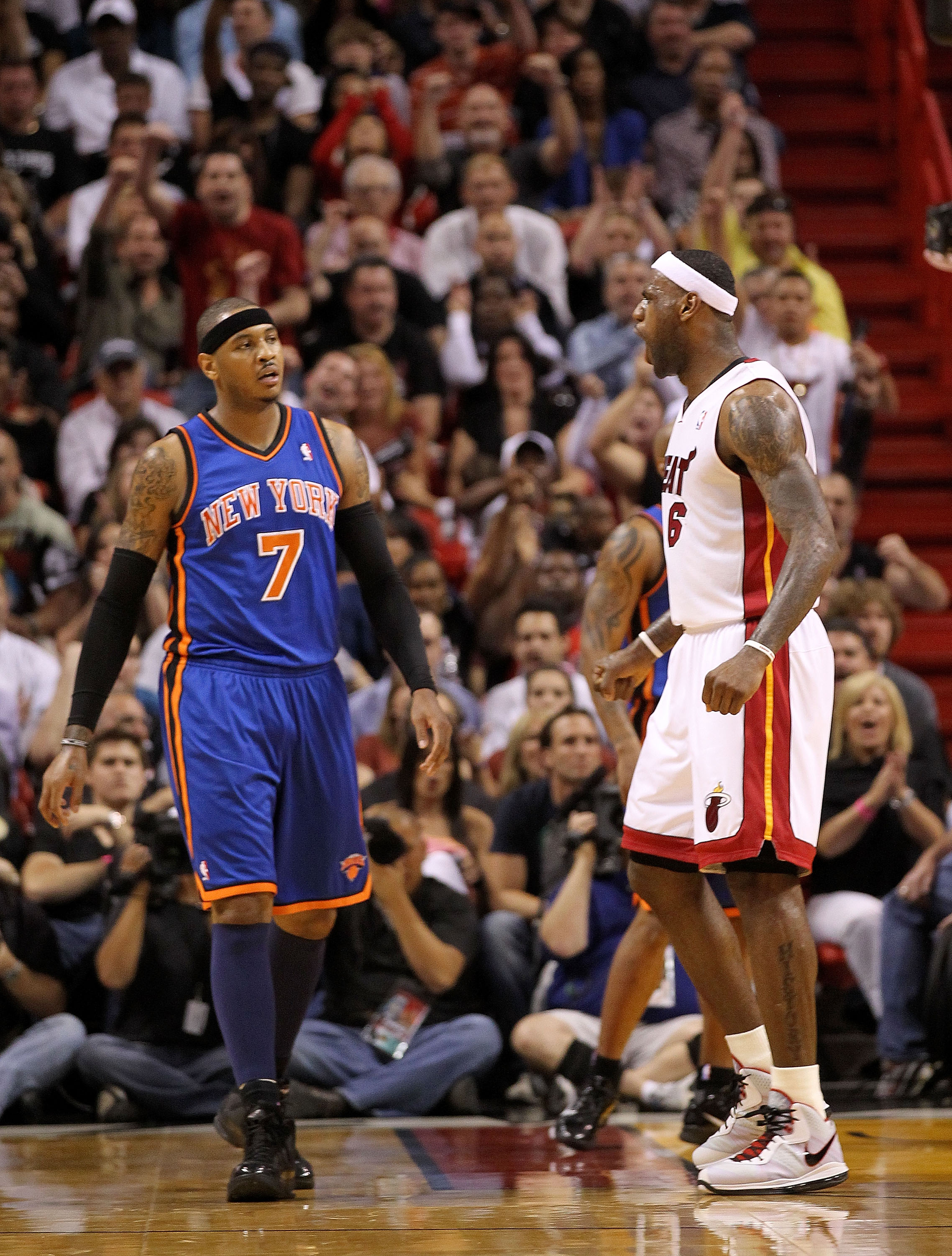 MIAMI, FL - FEBRUARY 27: LeBron James #6 of the Miami Heat reacts to a shot as Carmelo Anthony #7 of the New York Knicks looks on during a game at American Airlines Arena on February 27, 2011 in Miami, Florida. NOTE TO USER: User expressly acknowledges an