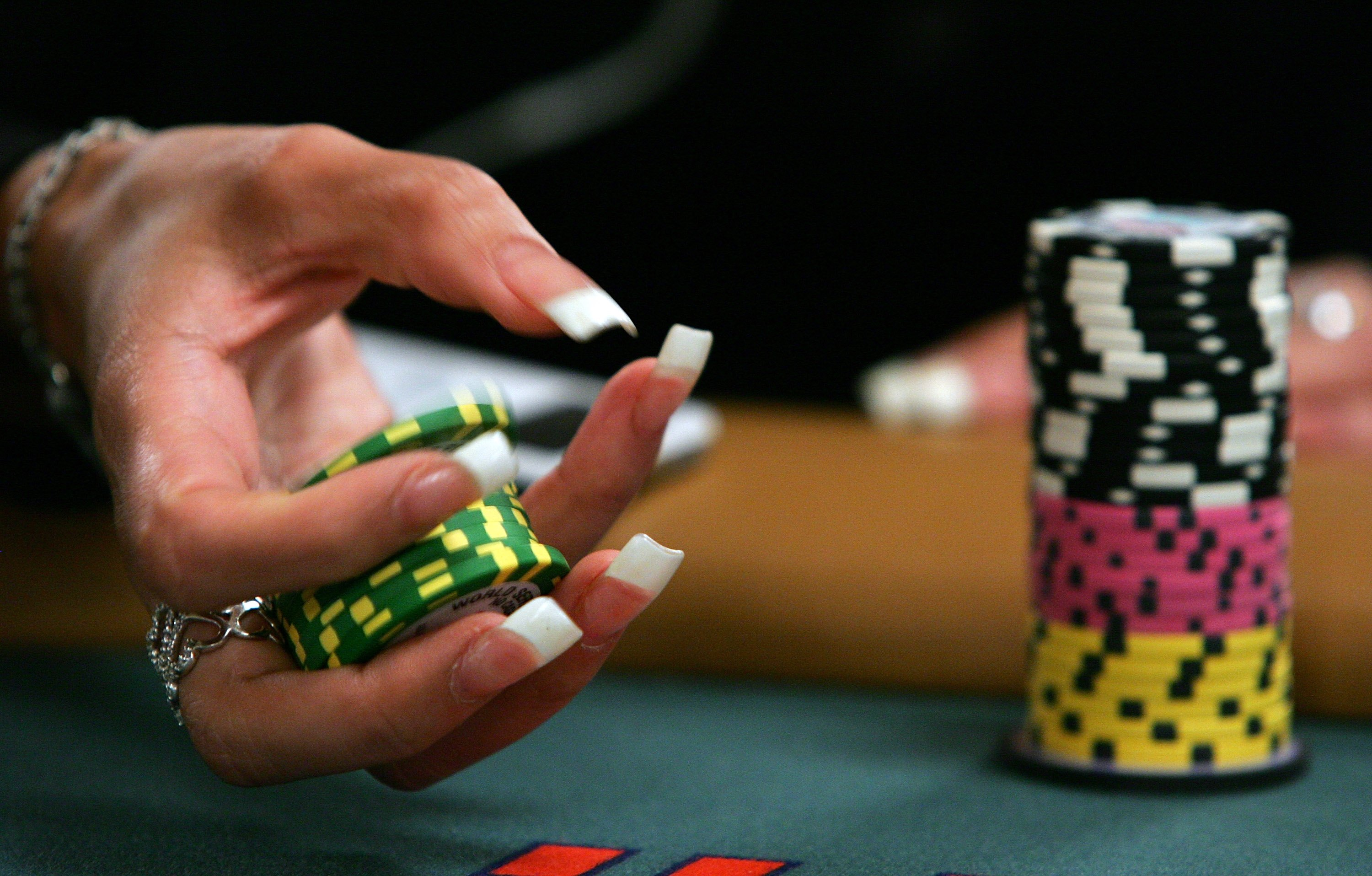 LAS VEGAS - JULY 30:  Poker player Liz Lieu plays with her chips as she competes on the third day of the first round of the World Series of Poker no-limit Texas Hold 'em main event at the Rio Hotel & Casino July 30, 2006 in Las Vegas, Nevada. More than 8,