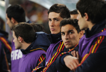 JOHANNESBURG, SOUTH AFRICA - JULY 11:  Fernando Torres of Spain looks on from the substitutes bench during the 2010 FIFA World Cup South Africa Final match between Netherlands and Spain at Soccer City Stadium on July 11, 2010 in Johannesburg, South Africa