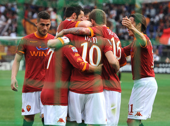 ROME, ITALY - APRIL 16:  Francesco Totti of Roma celebrates with mates after scoring the opening goal during the Serie A match between AS Roma and US Citta di Palermo at Stadio Olimpico on April 16, 2011 in Rome, Italy.  (Photo by Tullio M. Puglia/Getty I