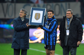 MILAN, ITALY - JANUARY 06:  FC Internazionale Milano President Massimo Moratti (L) and Javier Zanetti pose during the presentation of the FIFA Club World Cup Champions badge before the Serie A match between FC Internazionale Milano and SSC Napoli at Stadi