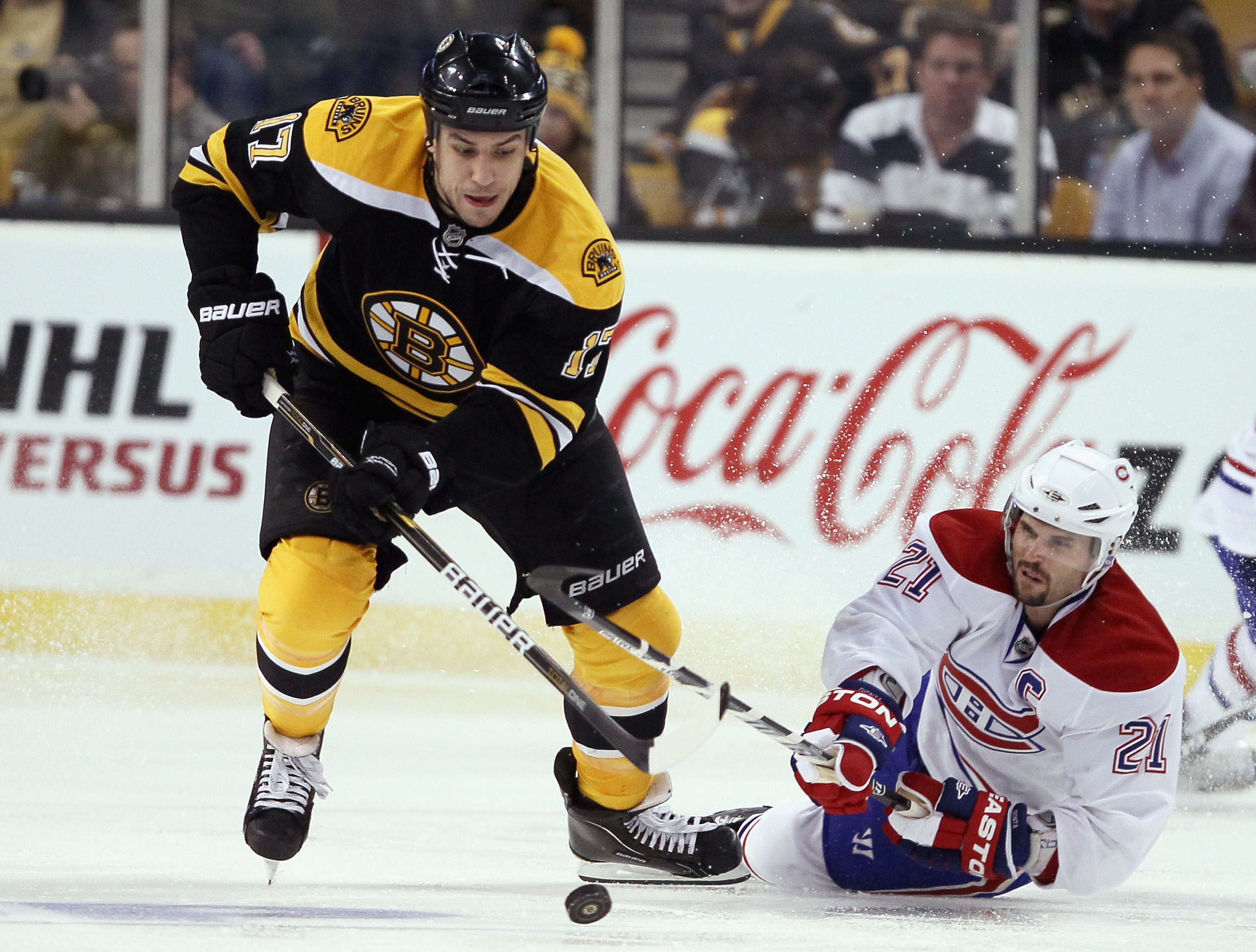 BOSTON, MA - APRIL 14:  Milan Lucic #17 of the Boston Bruins steals the puck from Brian Gionta #21 of the Montreal Canadiens in Game One of the Eastern Conference Quarterfinals during the 2011 NHL Stanley Cup Playoffs at TD Garden on April 14, 2011 in Bos