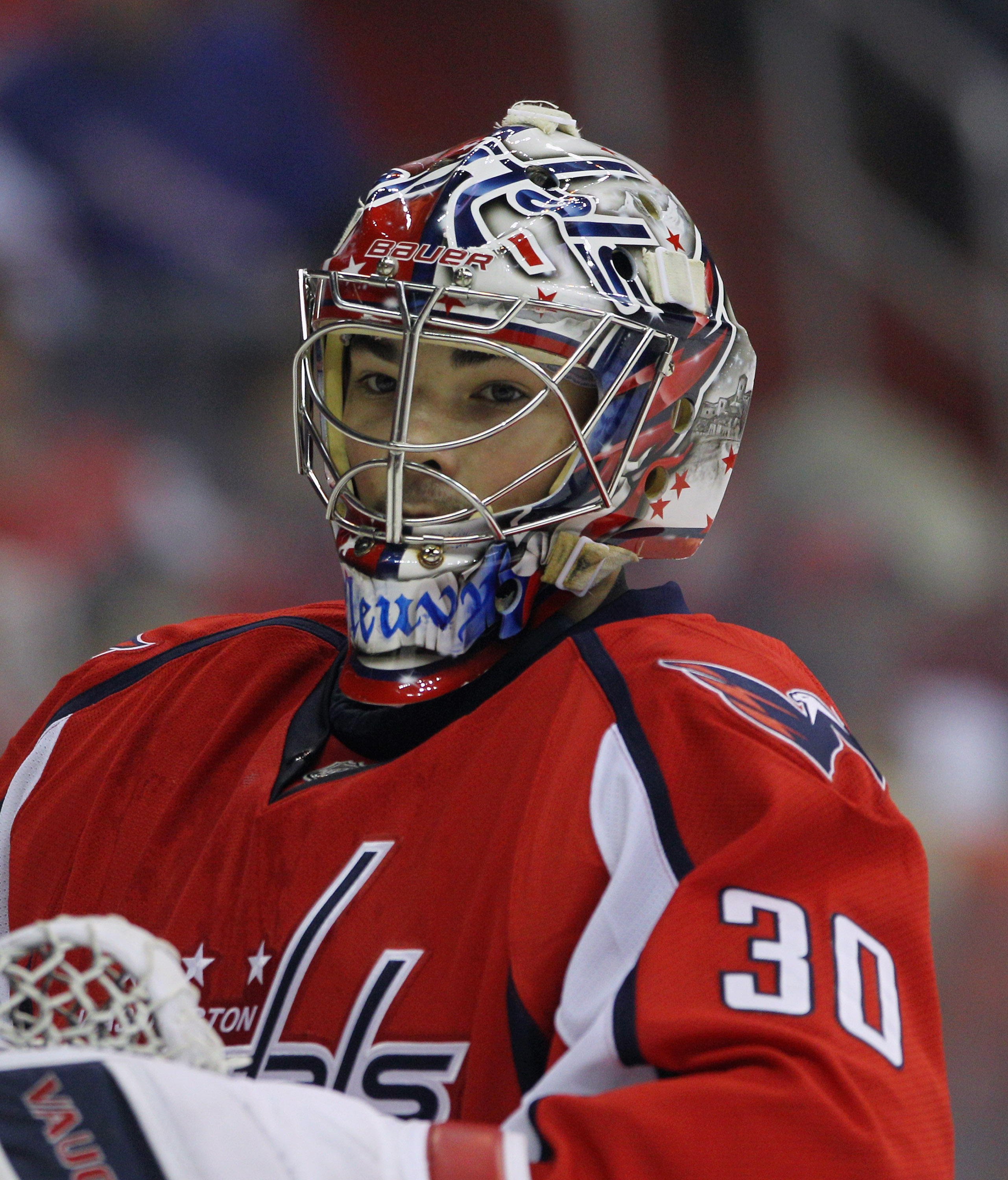 WASHINGTON, DC - APRIL 15:  Michal Neuvirth #30 of the Washington Capitals takes a break in the first period in the game against the New York Rangers in Game Two of the Eastern Conference Quarterfinals during the 2011 NHL Stanley Cup Playoffs at Verizon C