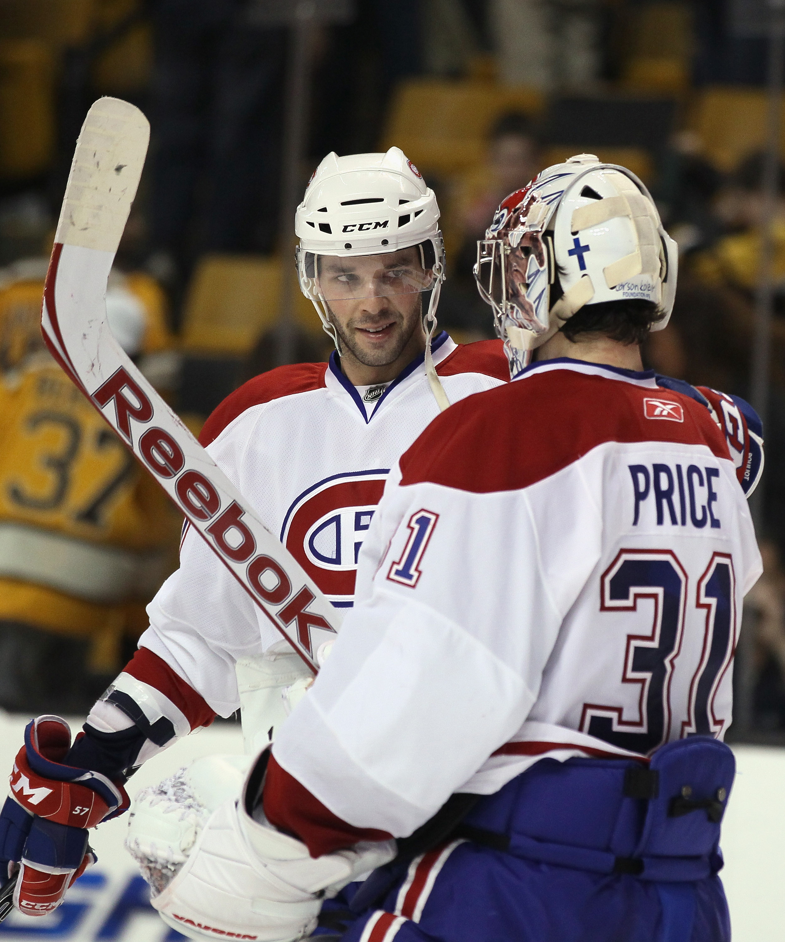 BOSTON, MA - APRIL 14:  Benoit Pouliot #57 of the Montreal Canadiens congratulates Carey Price #31 after Price shut out the Boston Bruins  in Game One of the Eastern Conference Quarterfinals during the 2011 NHL Stanley Cup Playoffs at TD Garden on April 1