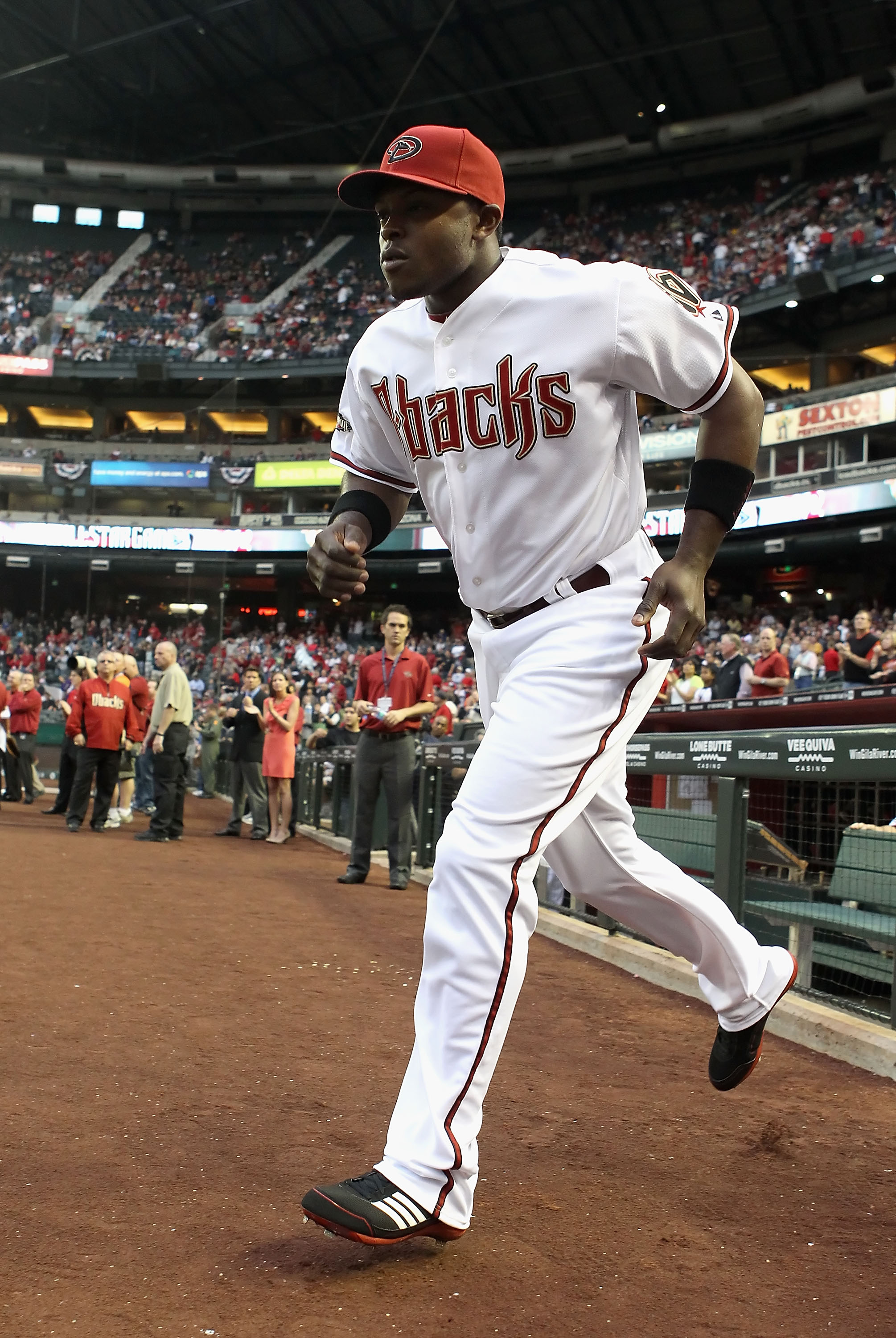 PHOENIX, AZ - APRIL 08:  Justin Upton #10 of the Arizona Diamondbacks runs out onto the field during introductions to the Major League Baseball home opening game against the Cincinnati Reds at Chase Field on April 8, 2011 in Phoenix, Arizona. The Diamondb