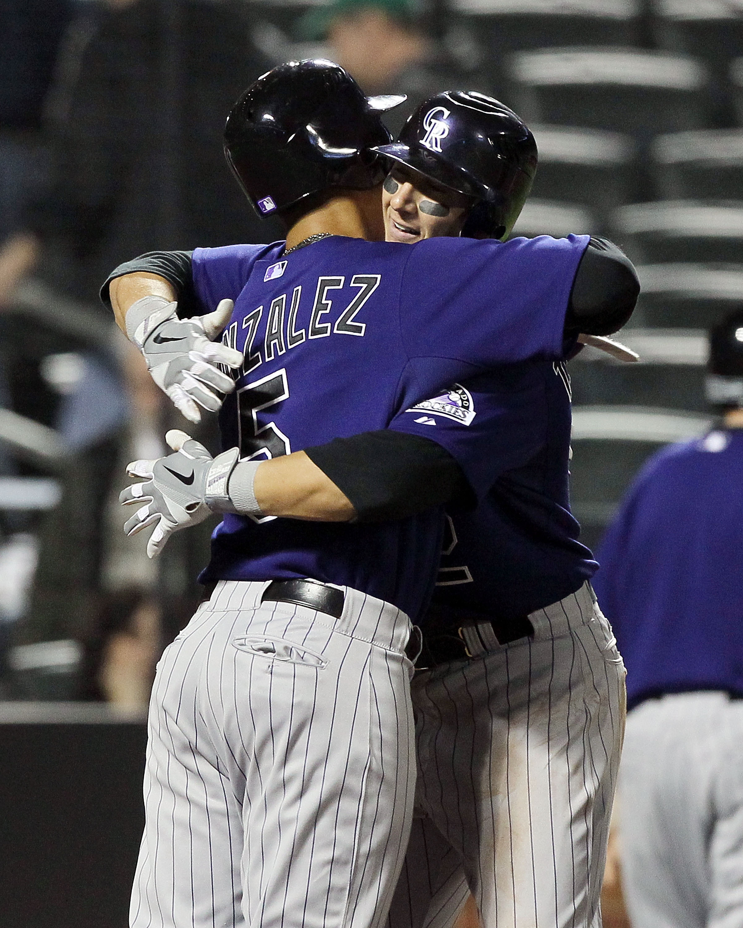NEW YORK, NY - APRIL 11:  Troy Tulowitzki #2 of the Colorado Rockies celebrates his seventh inning two-run home run against of the New York Mets with teammate Carlos Gonzalez #5 on April 11, 2011 at Citi Field in the Flushing neighborhood of the Queens bo