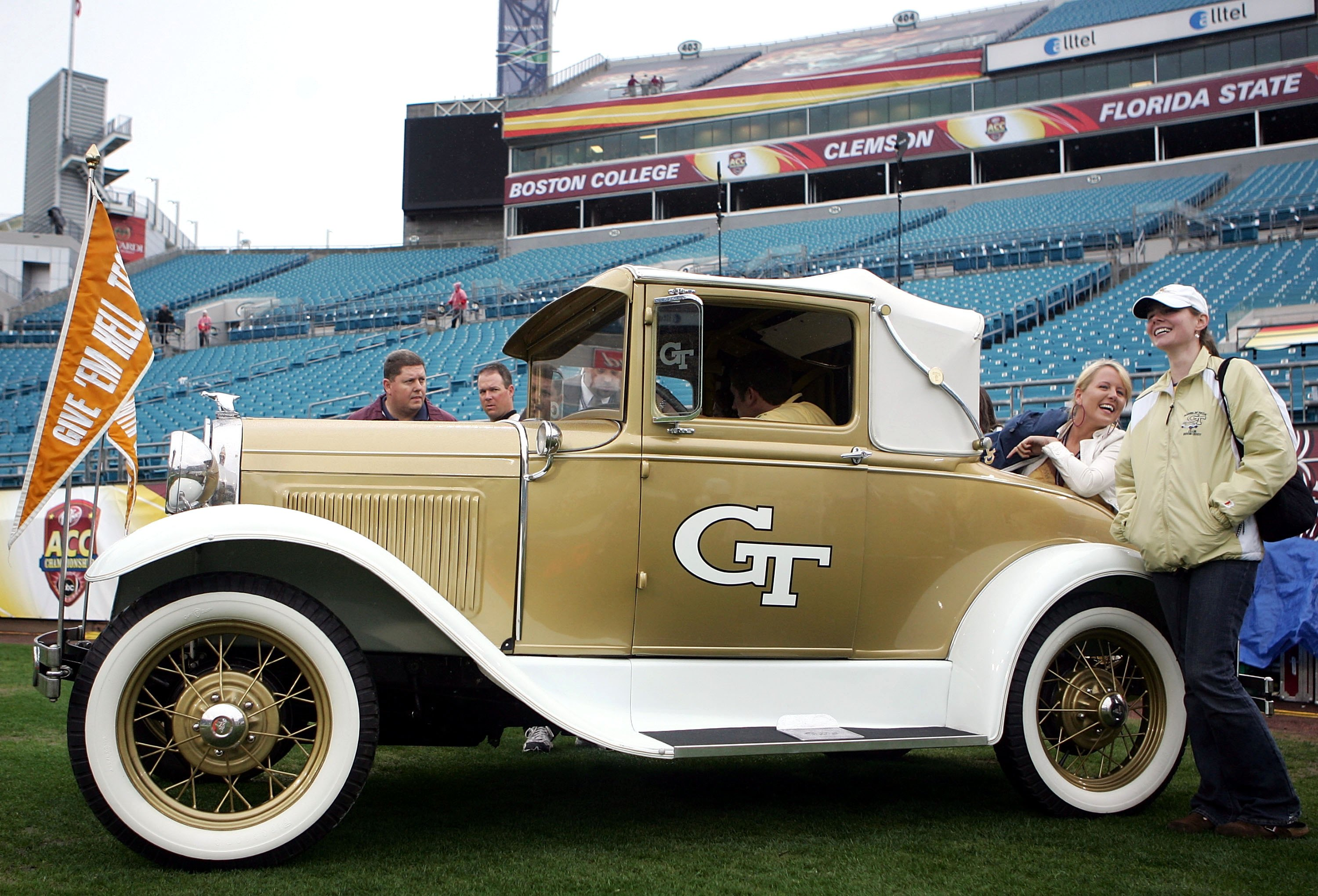 JACKSONVILLE, FL - DECEMBER 02:  Georgia Tech Yellow Jackets fans drive onto the field in an antique car prior to a game against the Wake Forest Demon Deacons during the Atlantic Coast Conference Championship on December 2, 2006 at Alltel Stadium in Jacks