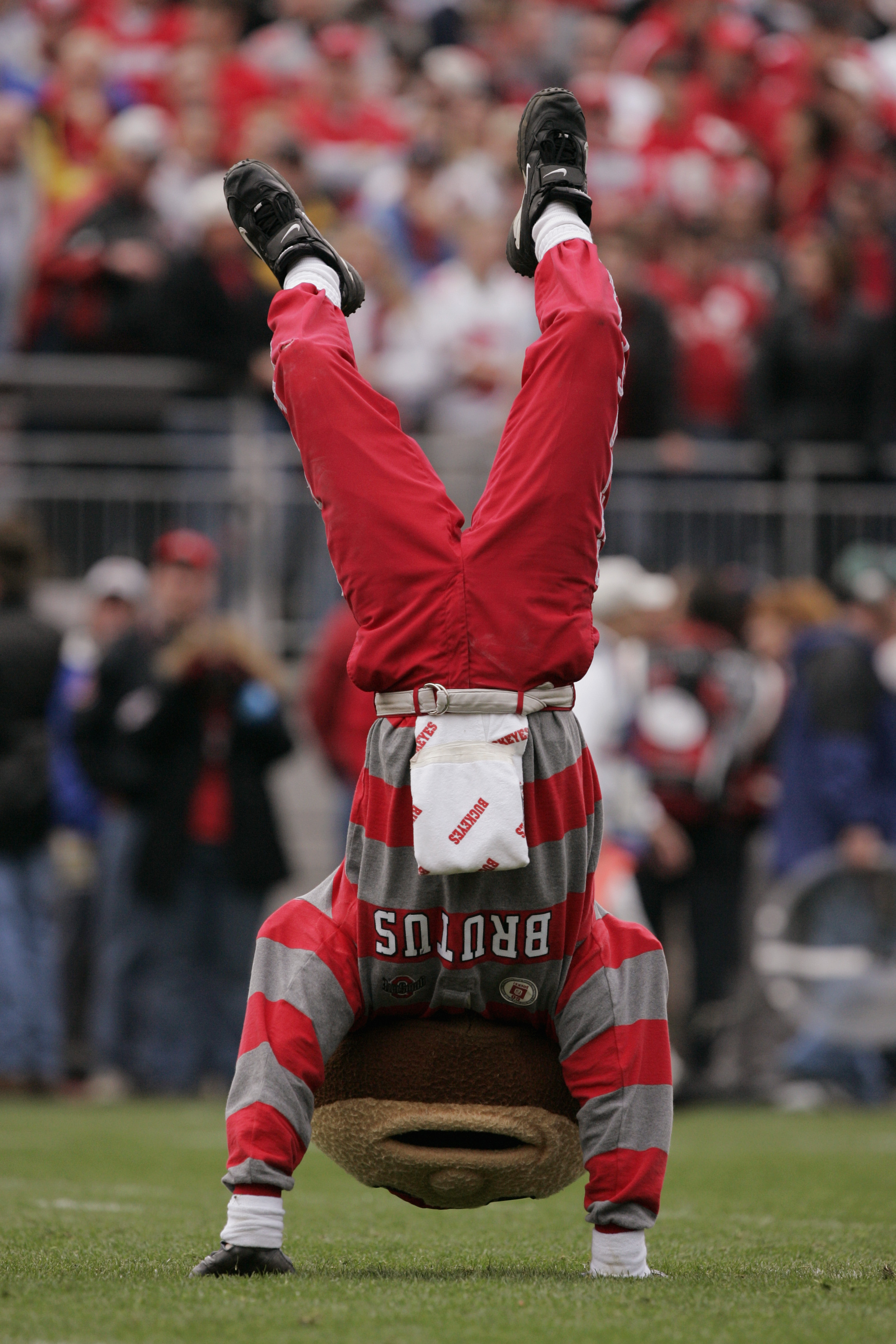 COLUMBUS, OH - NOVEMBER 20:  Brutus Buckeye, the mascot of the Ohio State University Buckeyes, performs during the game against the University of Michigan Wolverines on November 20, 2004 at Ohio Stadium in Columbus, Ohio.  Ohio State defeated Michigan 37-