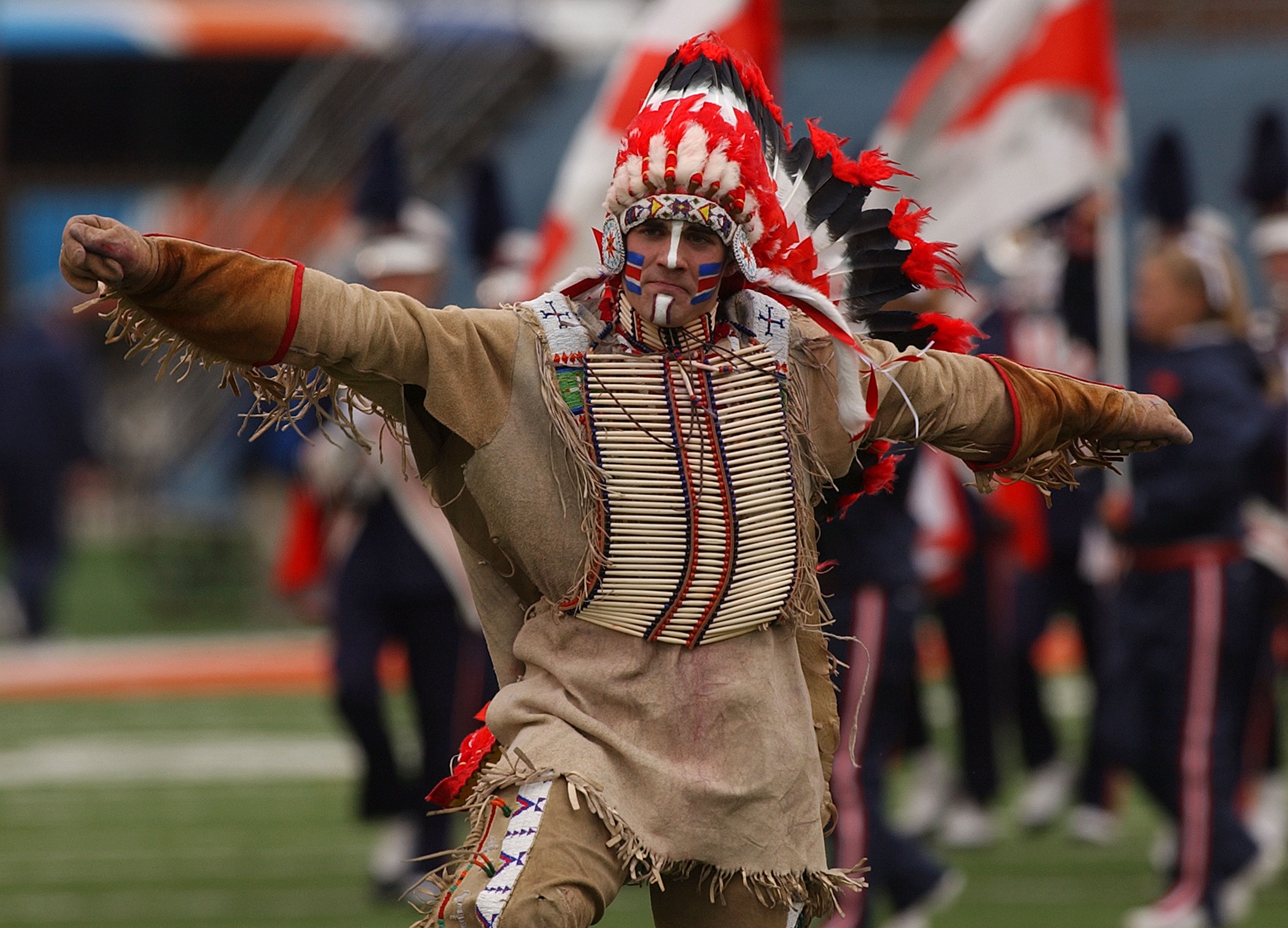 CHAMPAIGN, IL - OCTOBER 16: Controversial symbol 'Chief Illiniwek' of the University of Illinois performs during the half-time show of a game between Illinois and Michigan at Memorial Stadium October 16, 2004 in Champaign, Illinois. Michigan defeated Illi