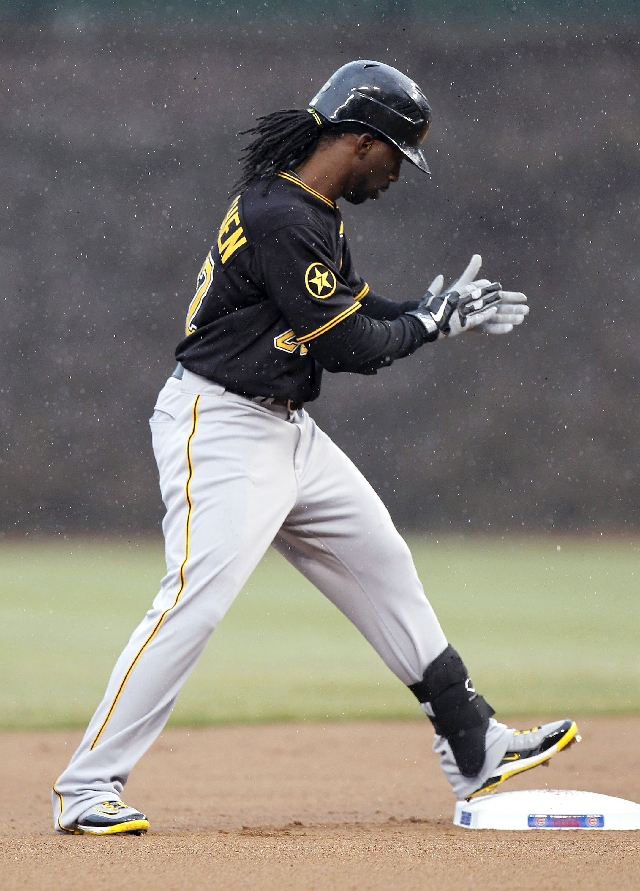 CHICAGO, IL - APRIL 01:  Andrew McCutchen #22 of the Pittsburgh Pirates reacts after hitting a first inning double while playing the Chicago Cubs on opening day at Wrigley Field on April 1, 2011 in Chicago, Illinois. Pittsburgh won the game 6-3.  (Photo b