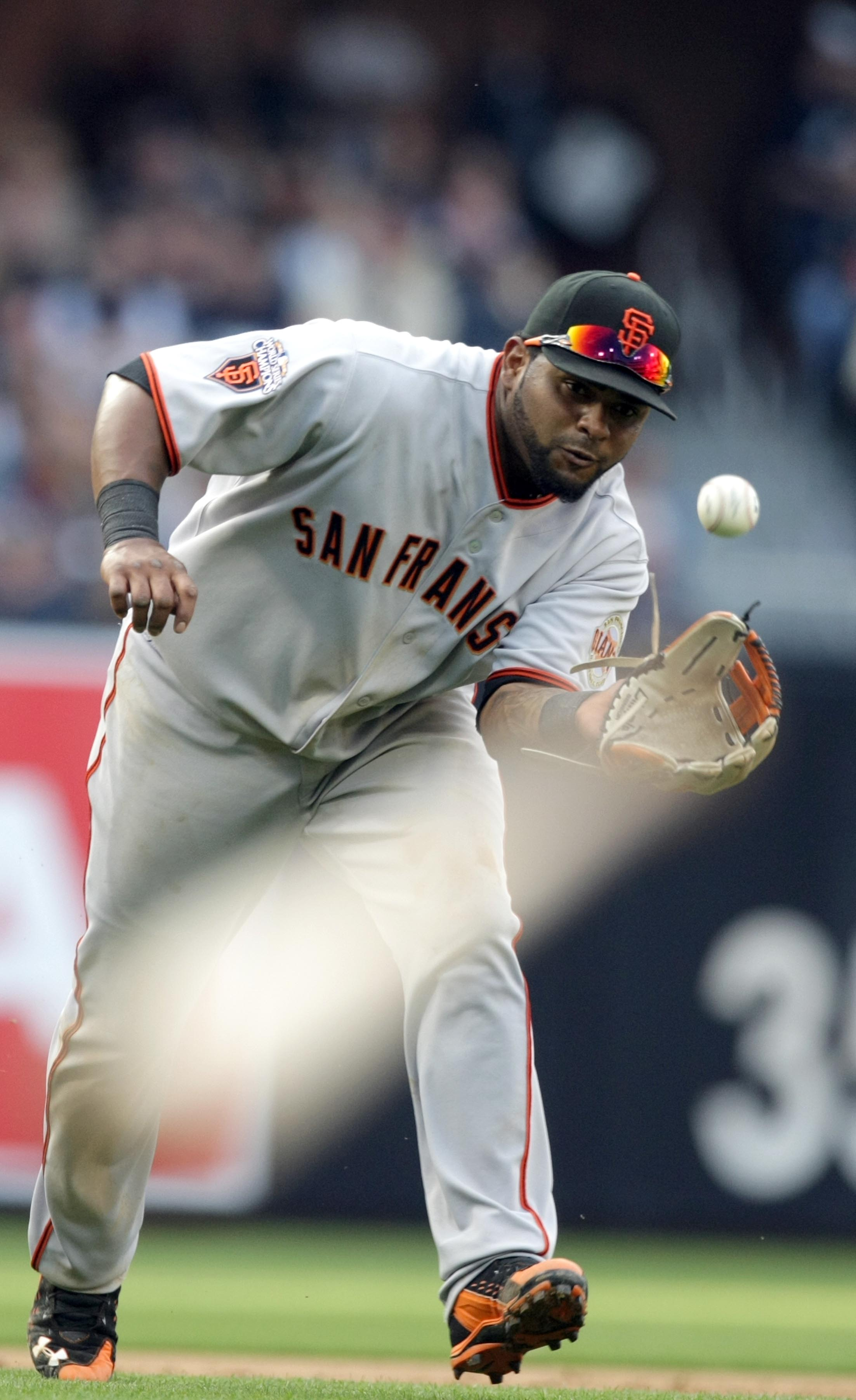 SAN DIEGO, CA - APRIL 5:  Pablo Sandoval #48 of the San Francisco Giants fields a ball against the San Diego Padres during their MLB Game at Petco Park on April 5, 2011 in San Diego, California. (Photo by Donald Miralle/Getty Images)