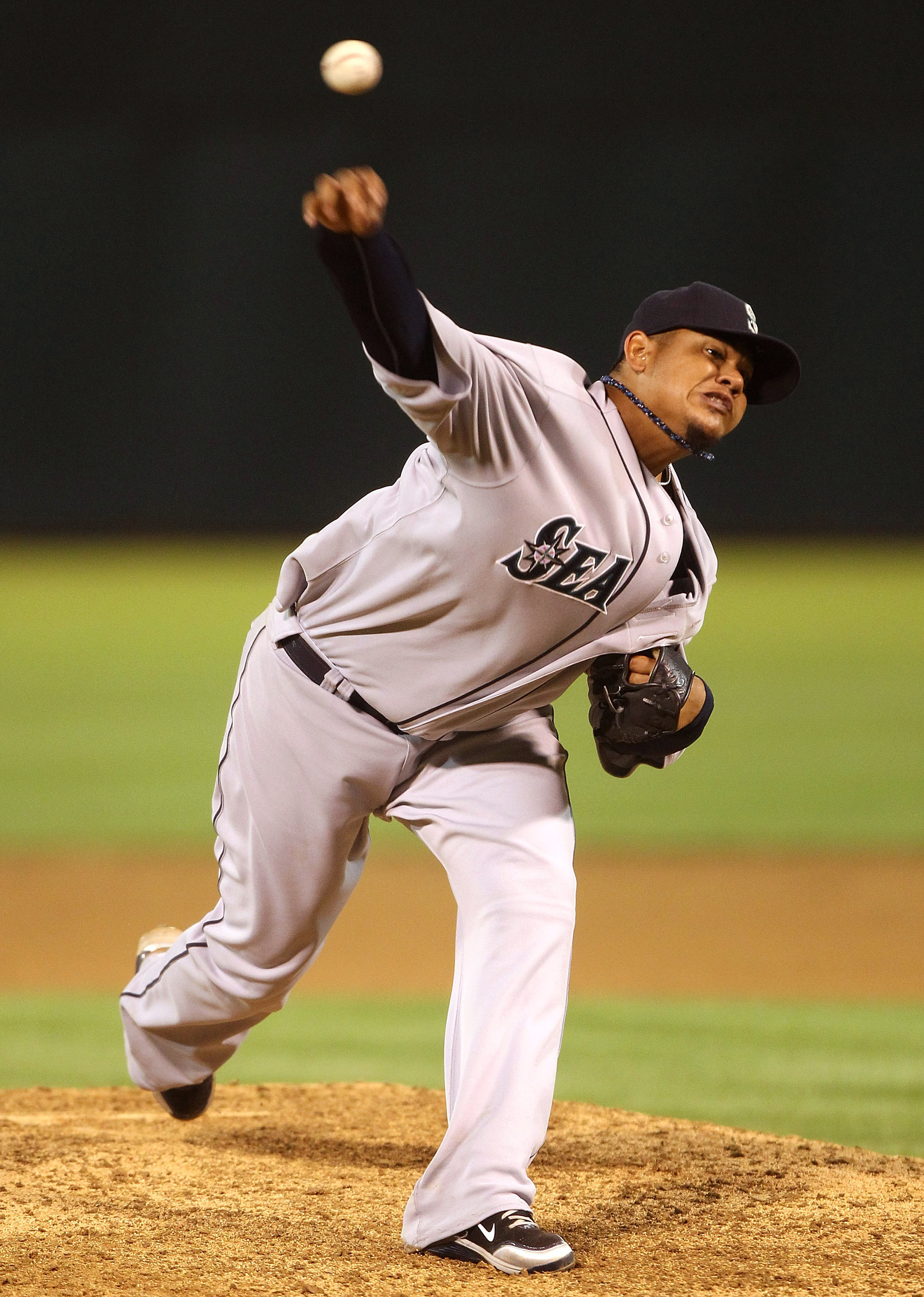 OAKLAND, CA - APRIL 01:  Felix Hernandez #34 of the Seattle Mariners pitches against the Oakland Athletics during an opening day game of Major League Baseball at the Oakland-Alameda County Coliseum on April 1, 2011 in Oakland, California.  (Photo by Jed J