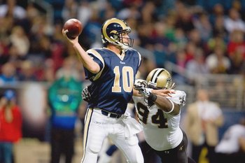 ST. LOUIS - NOVEMBER 15:  Quarterback Marc Bulger #10 of the St. Louis Rams looks to pass the ball against Charles Grant #94 of the New Orleans Saints at the Edward Jones Dome on November 15, 2009 in St. Louis, Missouri.  (Photo by Dilip Vishwanat/Getty I
