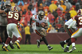 LANDOVER, MD - DECEMBER 12:  Carnell Williams #24 of the Tampa Bay Buccaneers runs the ball against the Washington Redskins  at FedExField on December 12, 2010 in Landover, Maryland. The Buccaneers defeated the Redskins 17-16. (Photo by Larry French/Getty
