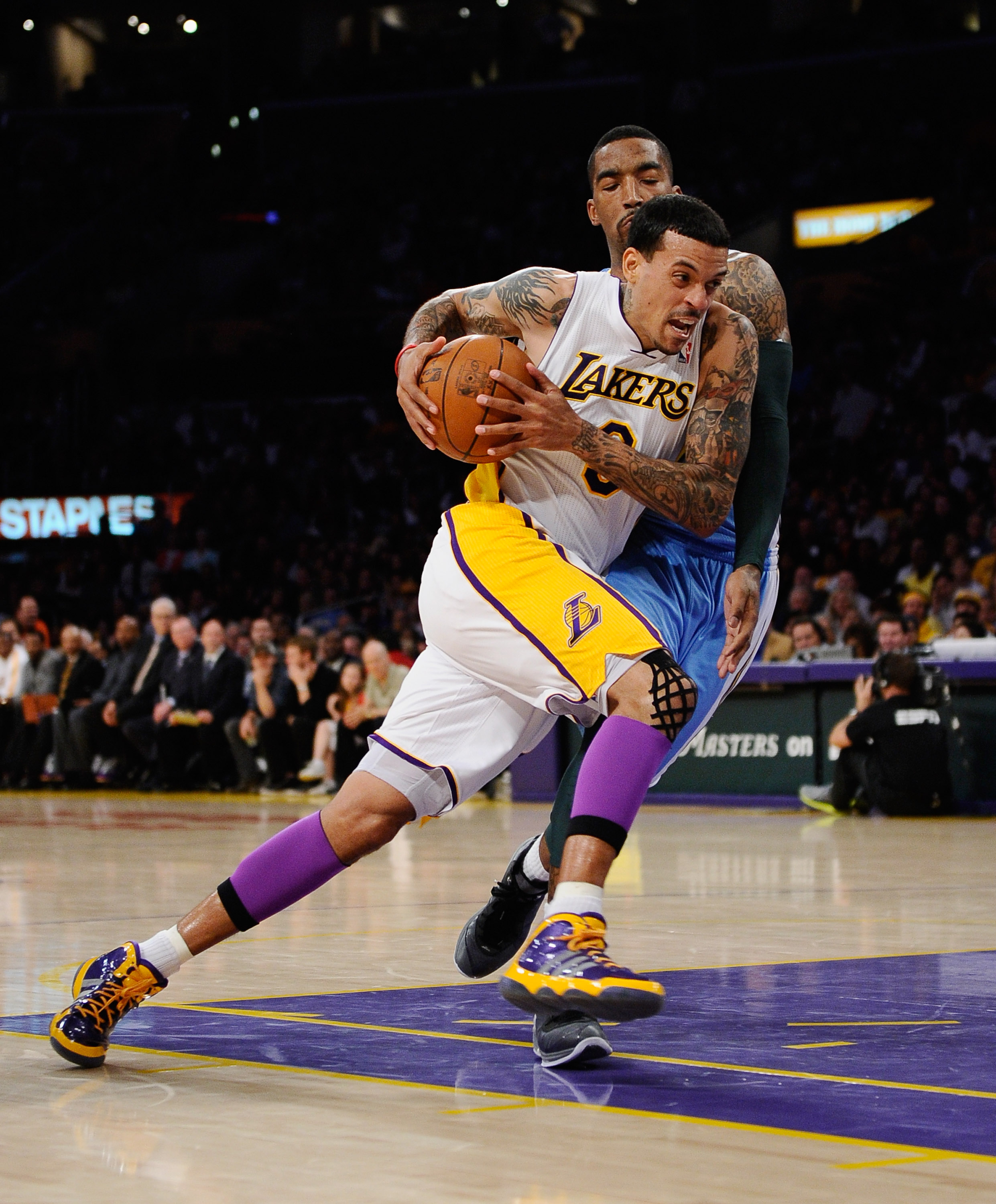 LOS ANGELES, CA - APRIL 03:  Matt Barnes #9 of the Los Angeles Lakers drives against JR Smith #5 of the Denver Nuggets at Staples Center on April 3, 2011 in Los Angeles, California. NOTE TO USER: User expressly acknowledges and agrees that, by downloading
