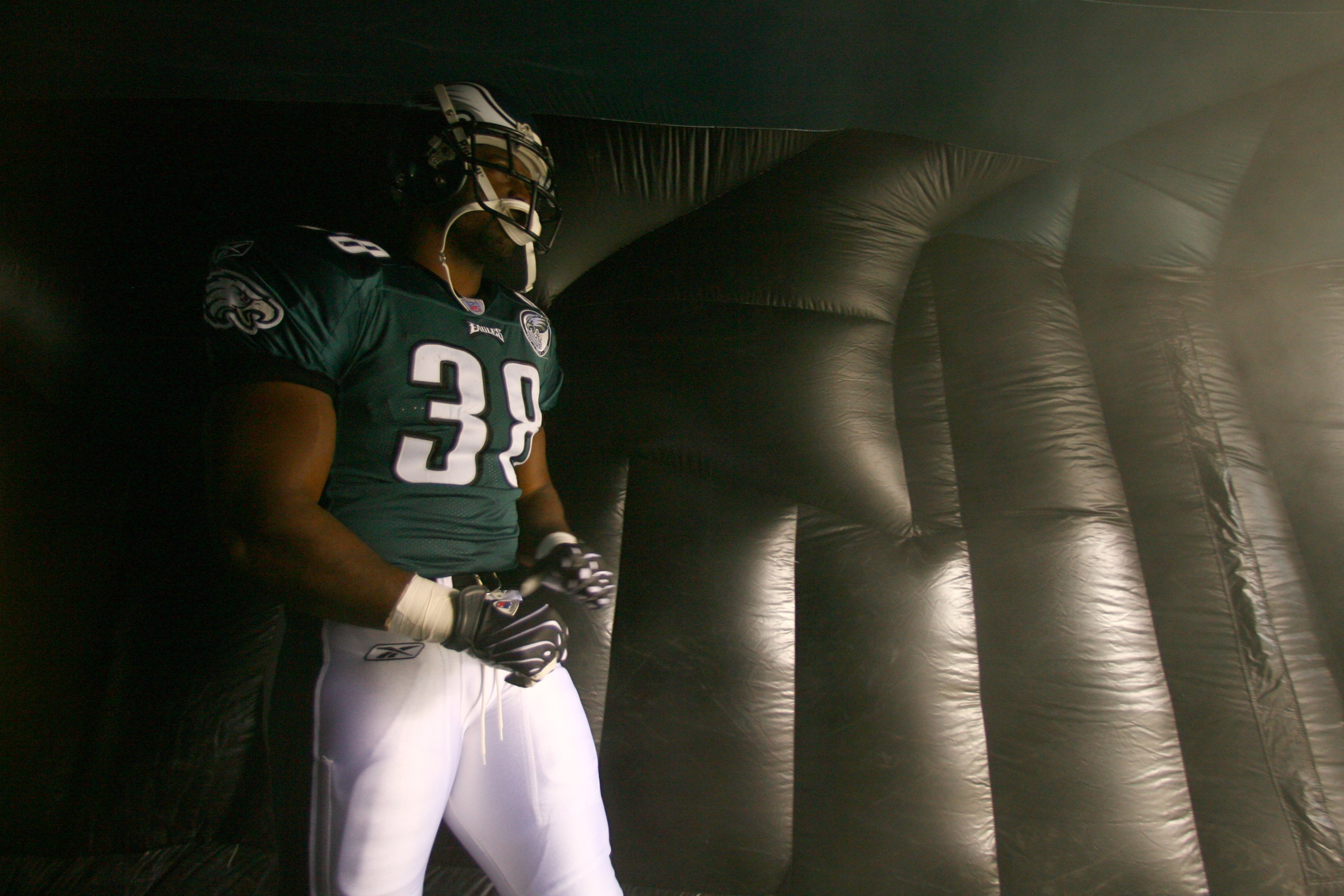 PHILADELPHIA - NOVEMBER 18:  Thomas Tapeh #38 of the Philadelphia Eagles enters the arena during the NFL game against the Miami Dolphins at Lincoln Financial Field on November 18, 2007 in Philadelphia, Pennsylvania. (Photo by Al Bello/Getty Images)
