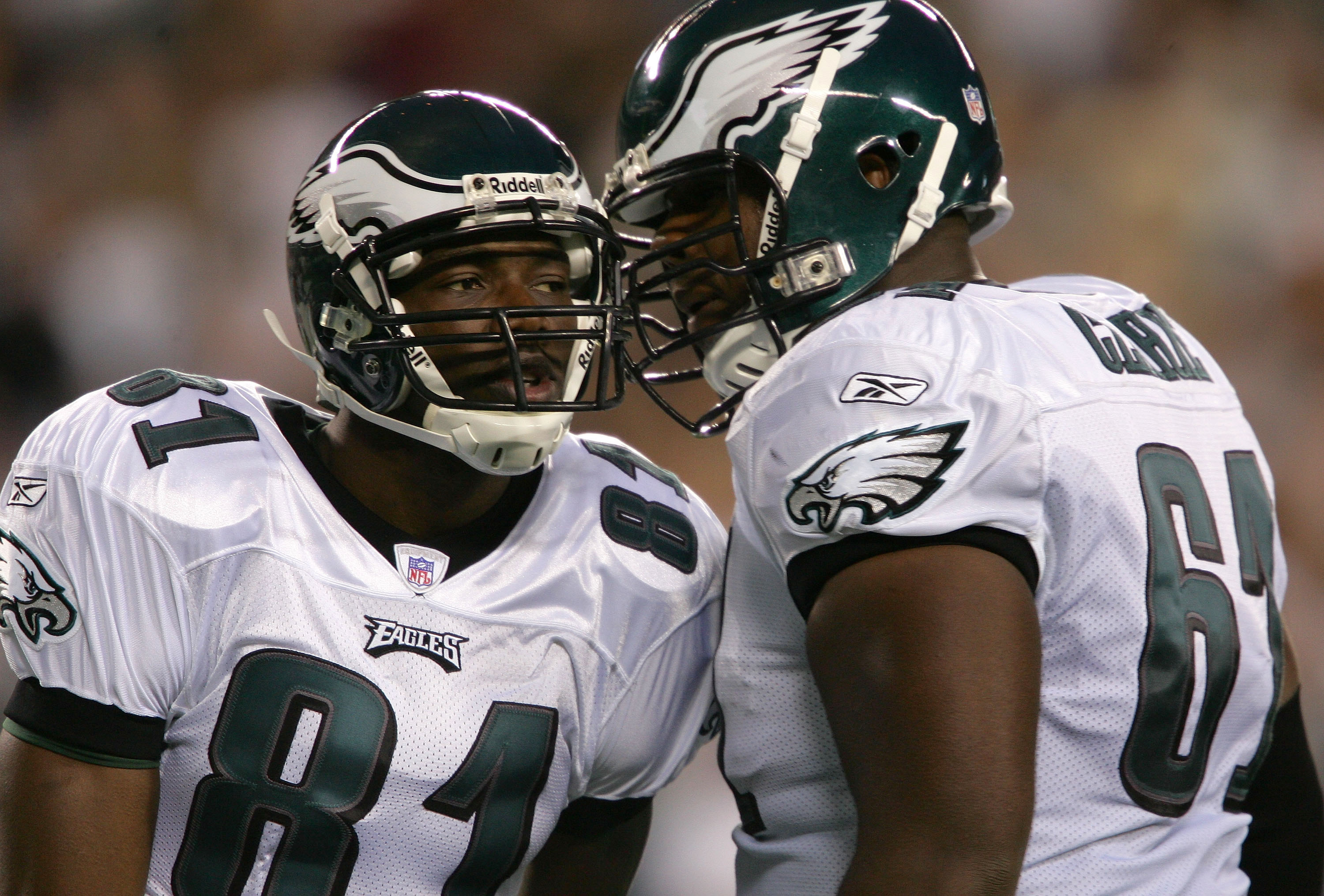 PHILADELPHIA - AUGUST 26:  Wide receiver Terrell Owens #81 of the Philadelphia Eagles celebrates his 64 yard touchdown reception on the first play of the game against the Cincinnati Bengals with teammate Adrien Clarke #61 in the first quarter of their pre