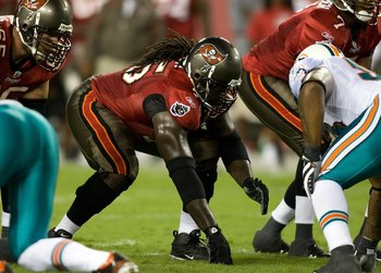 TAMPA, FL - AUGUST 27:  Offensive lineman Davin Joseph #75 of the Tampa Bay Buccaneers lines up against the Miami Dolphins during a preseason game at Raymond James Stadium on August 27, 2009 in Tampa, Florida.  (Photo by J. Meric/Getty Images)
