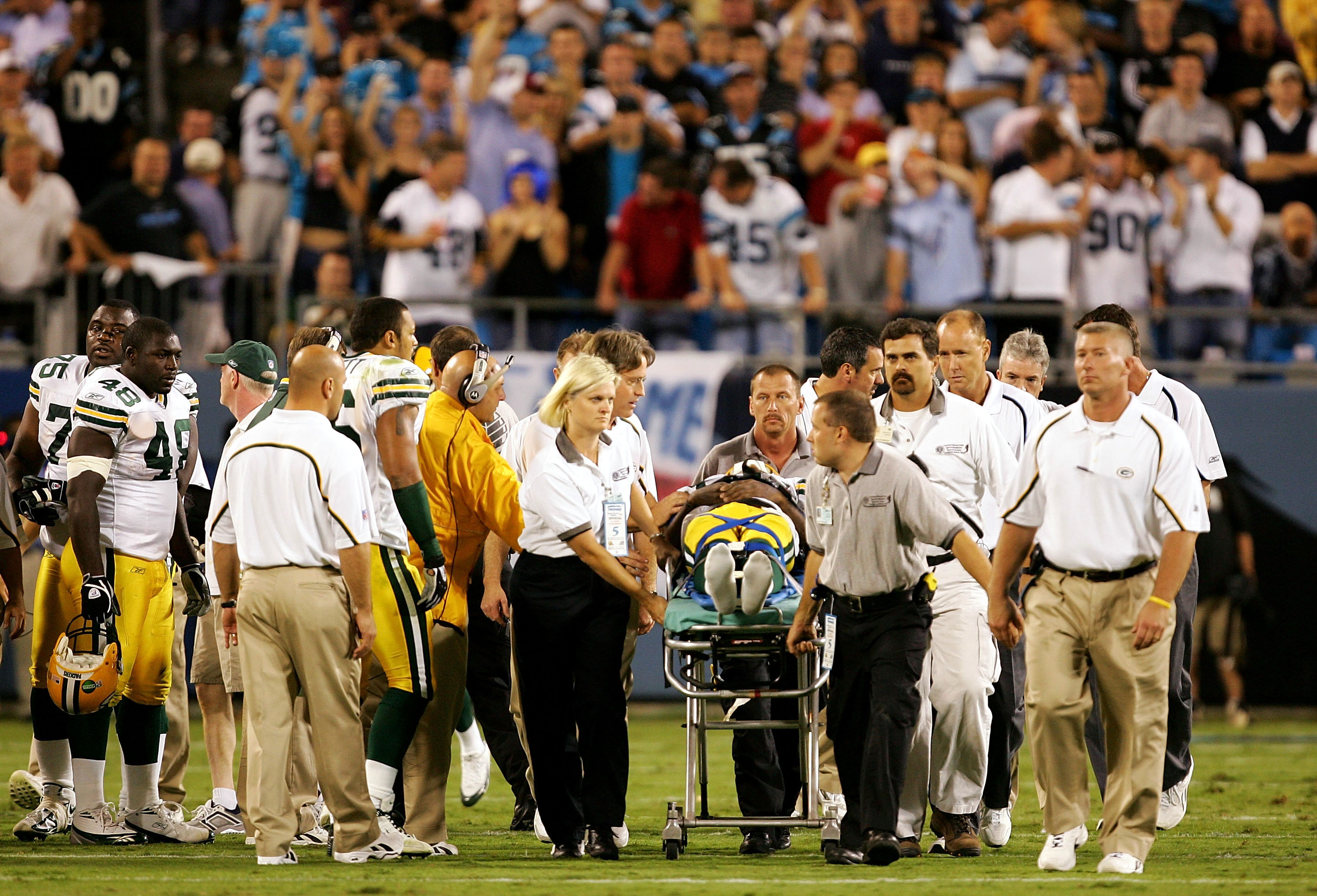 CHARLOTTE, NC - OCTOBER 03:  Terrence Murphy #85 of the Green Bay Packers is carried off the field during a game against the Carolina Panthers October 3, 2005 at Bank of America Stadium in Charlotte, North Carolina.  (Photo By Streeter Lecka/Getty Images)