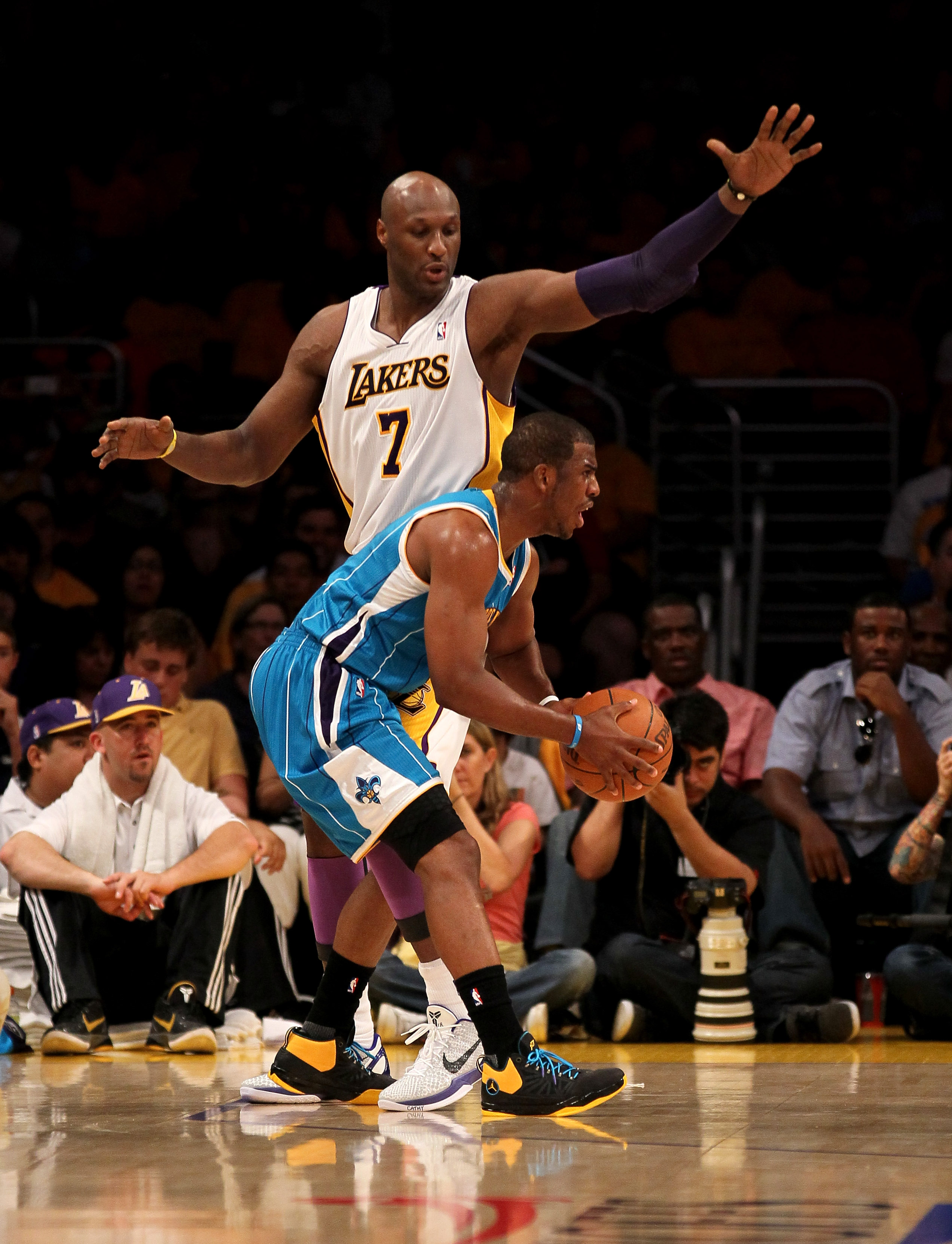 LOS ANGELES, CA - APRIL 17:  Chris Paul #3 of  the New Orleans Hornets controls the ball against Lamar Odom #7 of the Los Angeles Lakers in Game One of the Western Conference Quarterfinals in the 2011 NBA Playoffs on April 17, 2011 at Staples Center in Lo