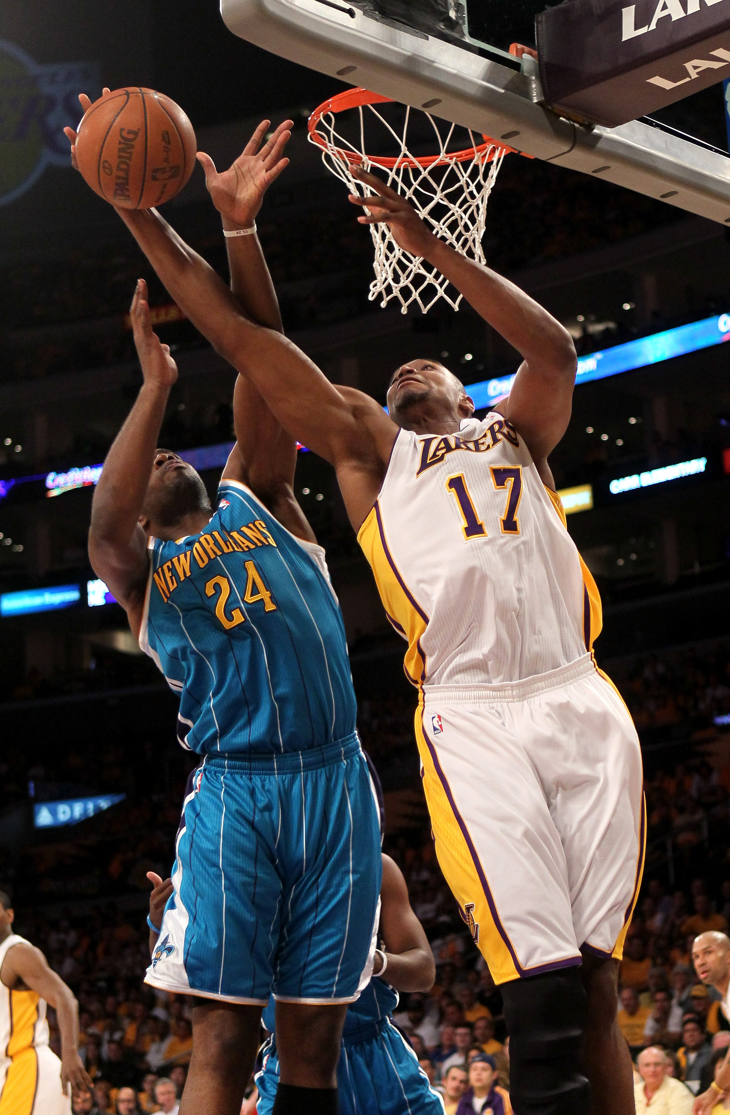 LOS ANGELES, CA - APRIL 17:  Andrew Bynum #17 of the Los Angeles Lakers grabs a rebound from carl Landry #24 of the New Orleans Hornets in Game One of the Western Conference Quarterfinals in the 2011 NBA Playoffs on April 17, 2011 at Staples Center in Los