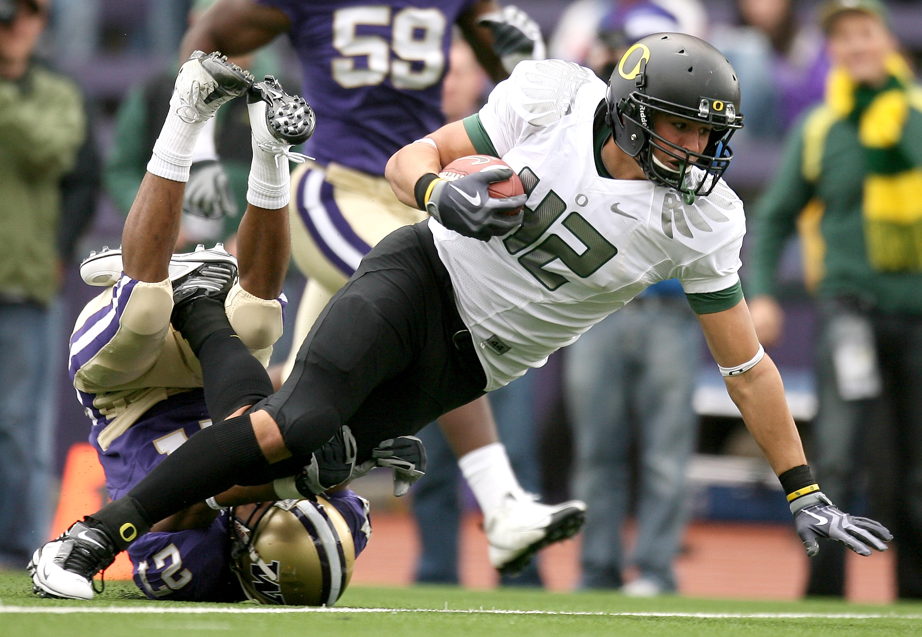 SEATTLE - OCTOBER 24:  Tight end David Paulson #42 of the Oregon Ducks rushes against Adam Long #27 of the Washington Huskies on October 24, 2009 at Husky Stadium in Seattle, Washington. The Ducks defeated the Huskies 43-19. (Photo by Otto Greule Jr/Getty