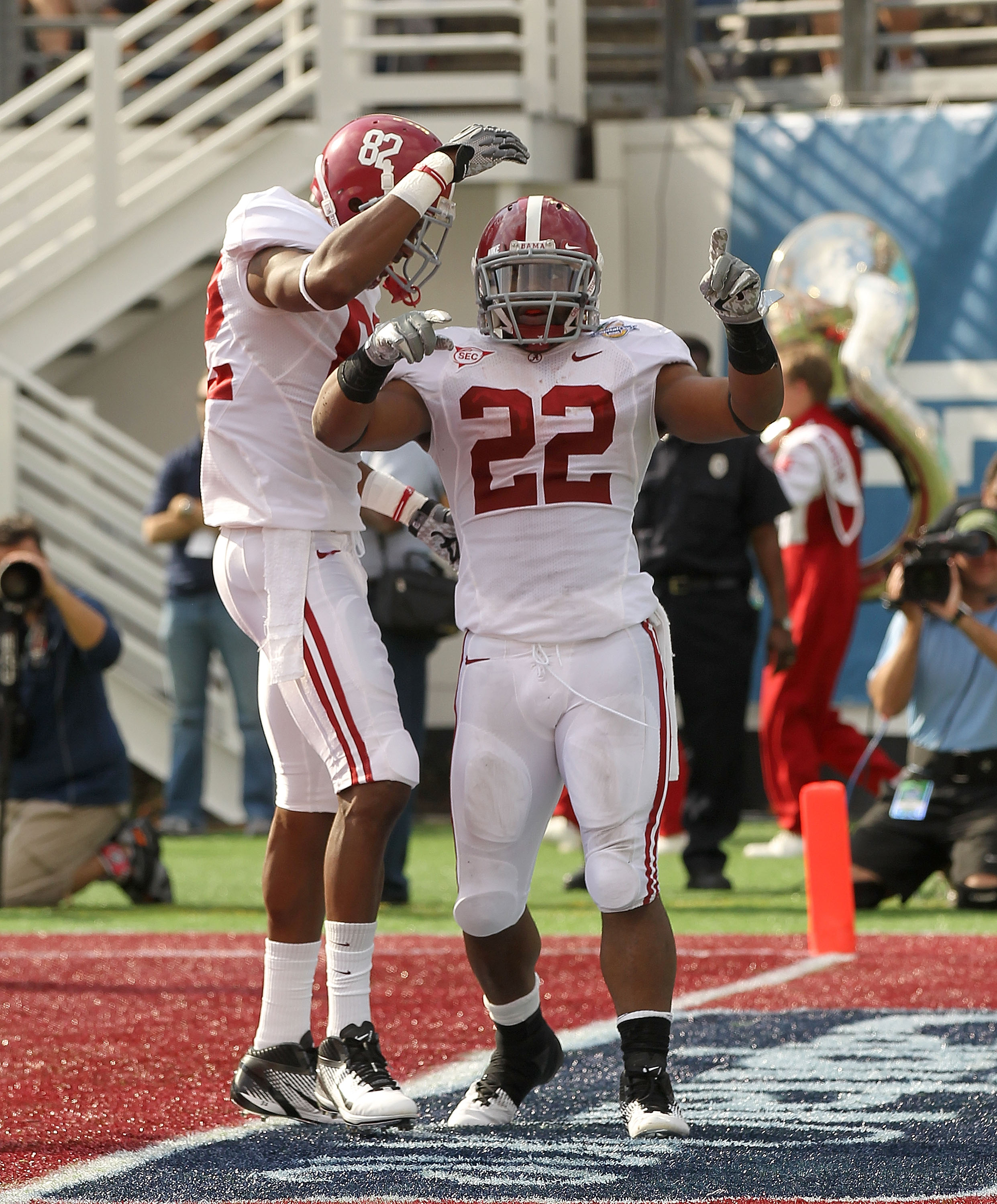 ORLANDO, FL - JANUARY 01:  Mark Ingram #22 of the Alabama Crimson Tide celebrates after rushing for a touchdown during the Capitol One Bowl against the Michigan State Spartans at the Florida Citrus Bowl on January 1, 2011 in Orlando, Florida.  (Photo by M