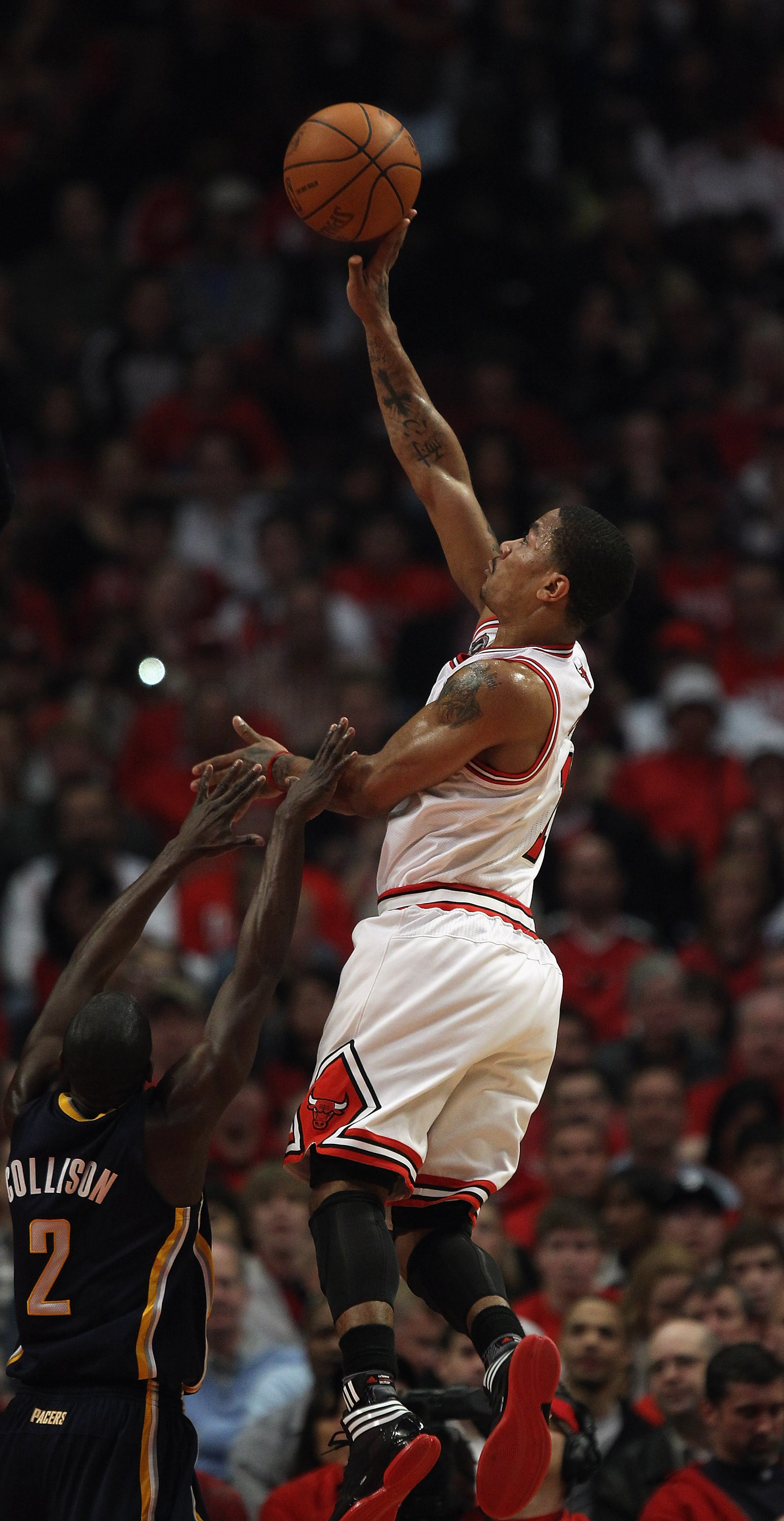 CHICAGO, IL - APRIL 16: Derrick Rose #1 of the Chicago Bulls puts up a shot over Darren Collison #2 of the Indiana Pacers in Game One of the Eastern Conference Quarterfinals in the 2011 NBA Playoffs at the United Center on April 16, 2011 in Chicago, Illin