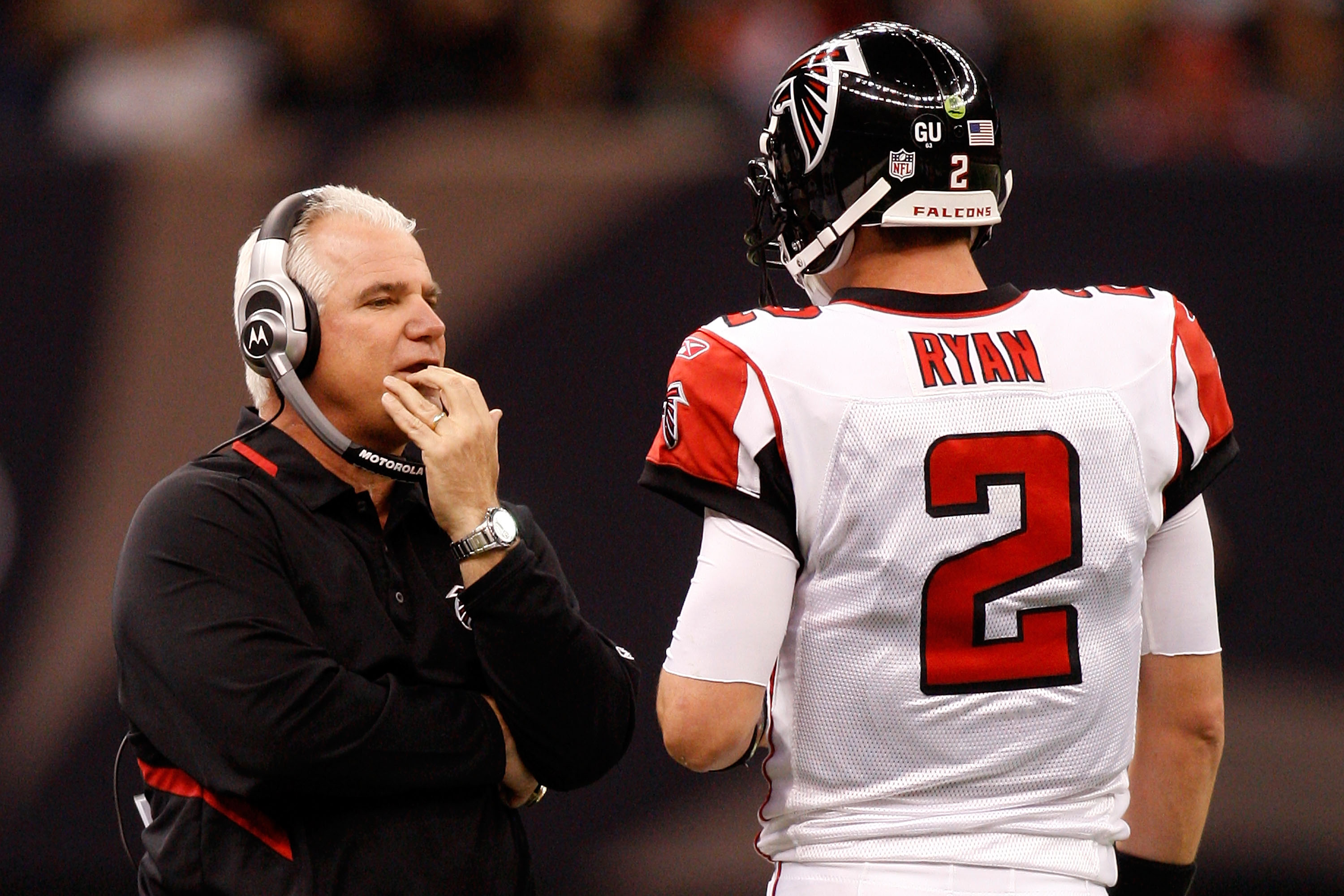NEW ORLEANS - DECEMBER 07:  Head coach Mike Smith talks with quarterback Matt Ryan #2 of the Atlanta Falcons throws a pass against the New Orleans Saints on December 7, 2008 at the Superdome in New Orleans, Louisiana.   The Saints defeated the Falcons 29-