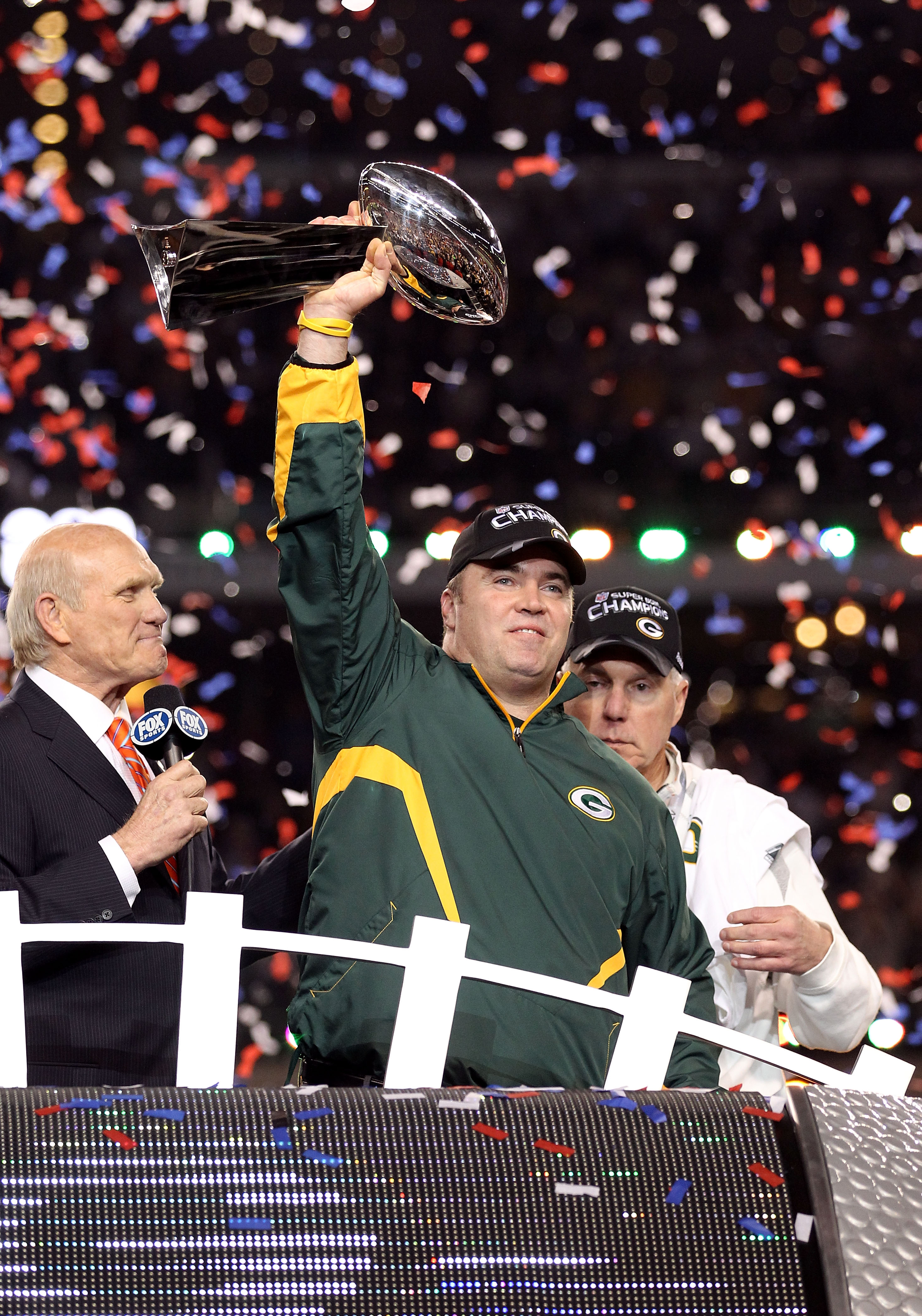 ARLINGTON, TX - FEBRUARY 06:  Head coach Mike McCarthy of the Green Bay Packers celebrates with the Vince Lombardi trophy following the Packers 31-25 win in Super Bowl XLV at Cowboys Stadium on February 6, 2011 in Arlington, Texas.  (Photo by Al Bello/Get