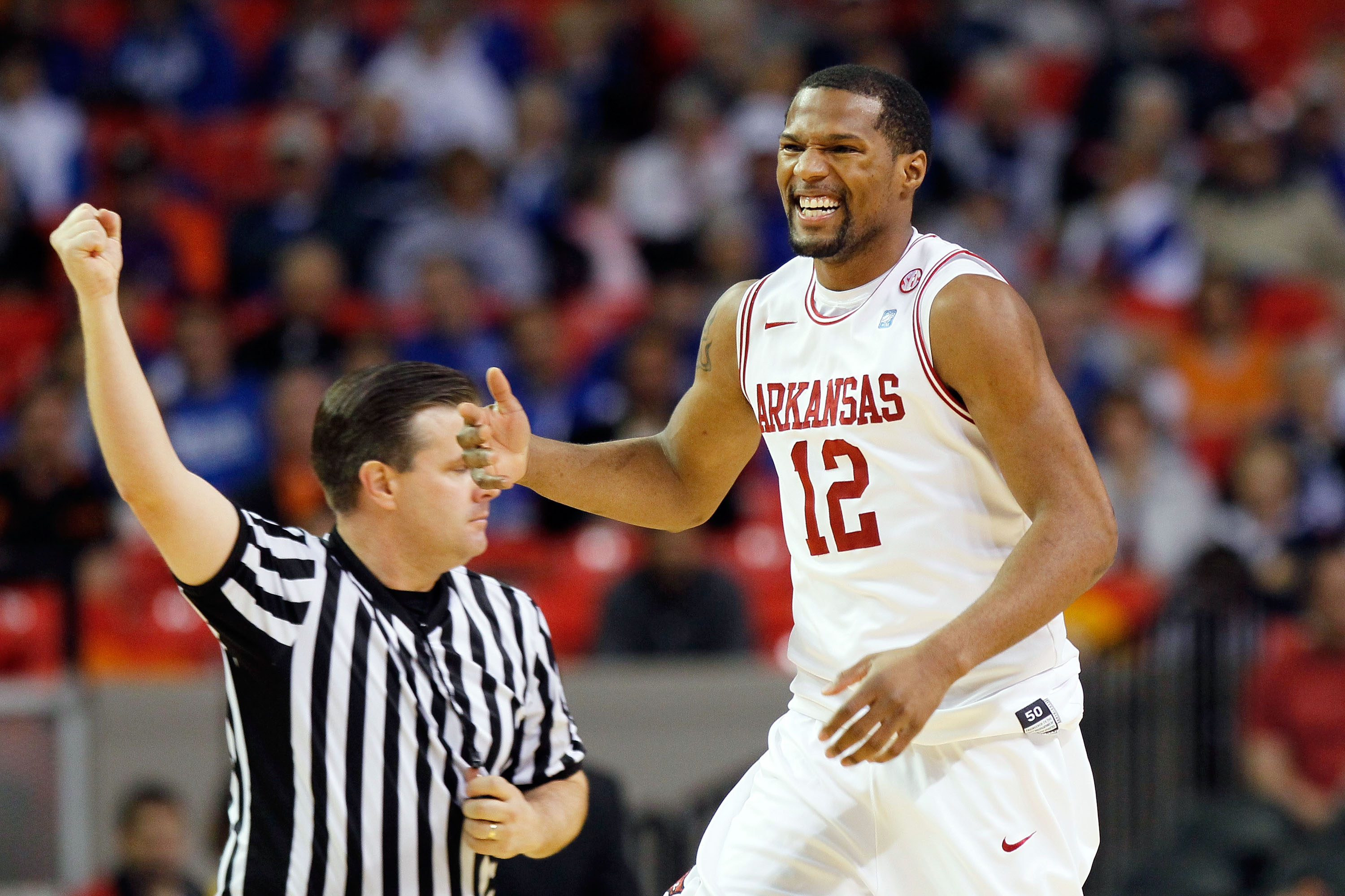 ATLANTA, GA - MARCH 10:  Marcus Britt #12 of the Arkansas Razorbacks reacts to a call during their game against the Tennessee Volunteers in the first round of the SEC Men's Basketball Tournament at the Georgia Dome on March 10, 2011 in Atlanta, Georgia.
