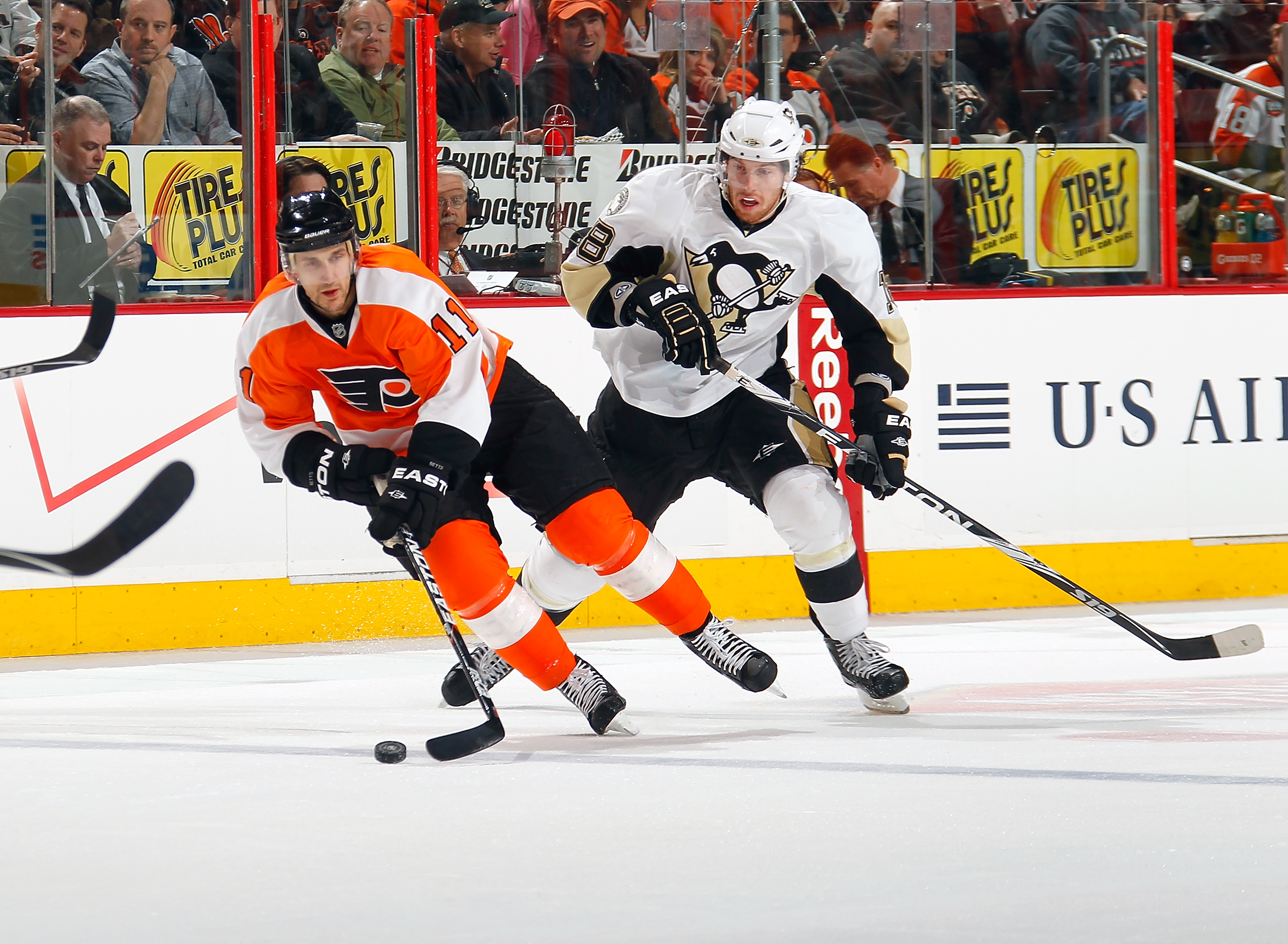PHILADELPHIA, PA - MARCH 24:  James Neal #18 of the Pittsburgh Penguins and Blair Betts #11 of the Philadelphia Flyers skate for the puck during a game on March 24, 2011 at the Wells Fargo Center in Philadelphia, Pennsylvania.  (Photo by Lou Capozzola/Get