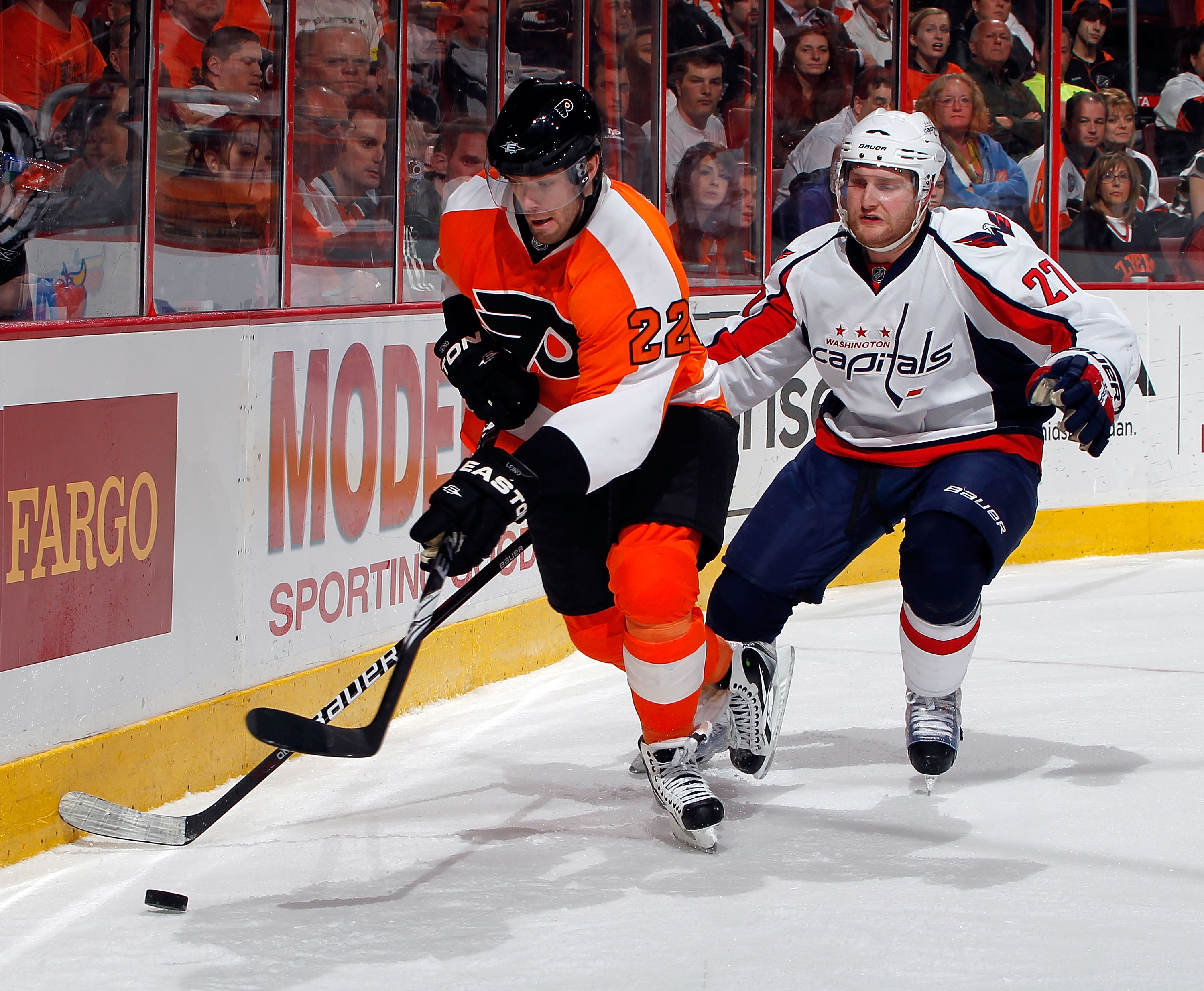 PHILADELPHIA, PA - MARCH 22:  Karl Azner #27 of the Washington Capitals skates after Ville Leino #22 of the Philadelphia Flyers during an NHL hockey game at the Wells Fargo Center on March 22, 2011 in Philadelphia, Pennsylvania.  (Photo by Paul Bereswill/