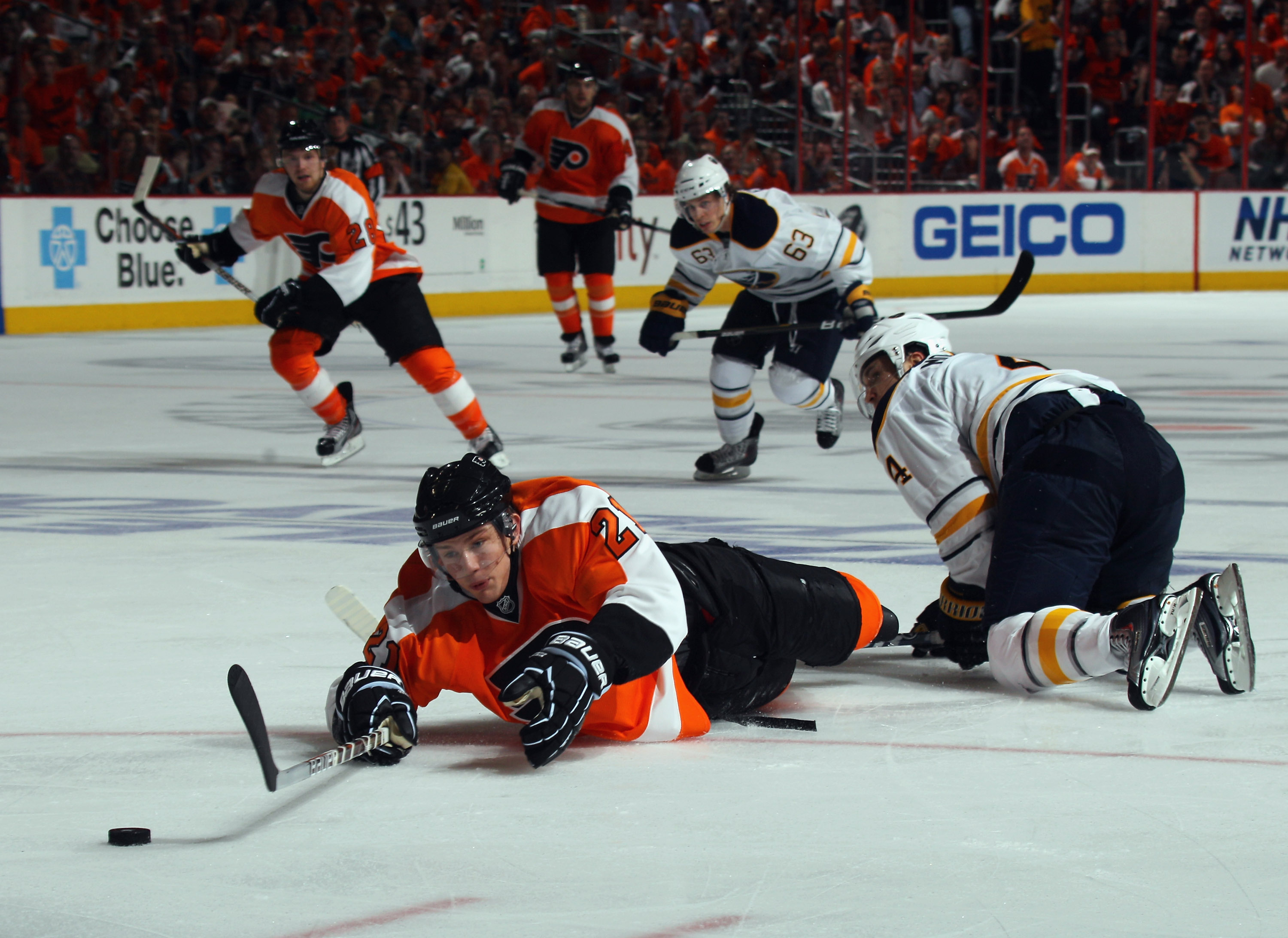 PHILADELPHIA, PA - APRIL 14:  Steve Montador #4 of the Buffalo Sabres takes a two minute penalty for tripping James van Riemsdyk #21 of the Philadelphia Flyers in Game One of the Eastern Conference Quarterfinals during the 2011 NHL Stanley Cup Playoffs at