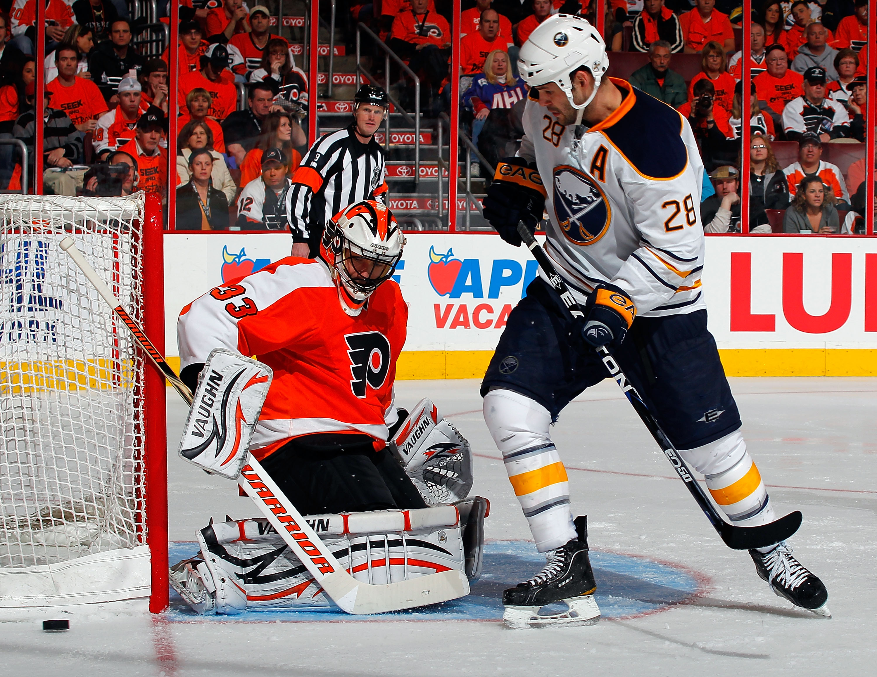 PHILADELPHIA, PA - APRIL 16:  Paul Gaustad #28 of the Buffalo Sabres watche goalie Brian Boucher #33 of the Philadelphia Flyers stop his shot during the third period of Game Two of the Eastern Conference Quarterfinals during the 2011 NHL Stanley Cup Playo