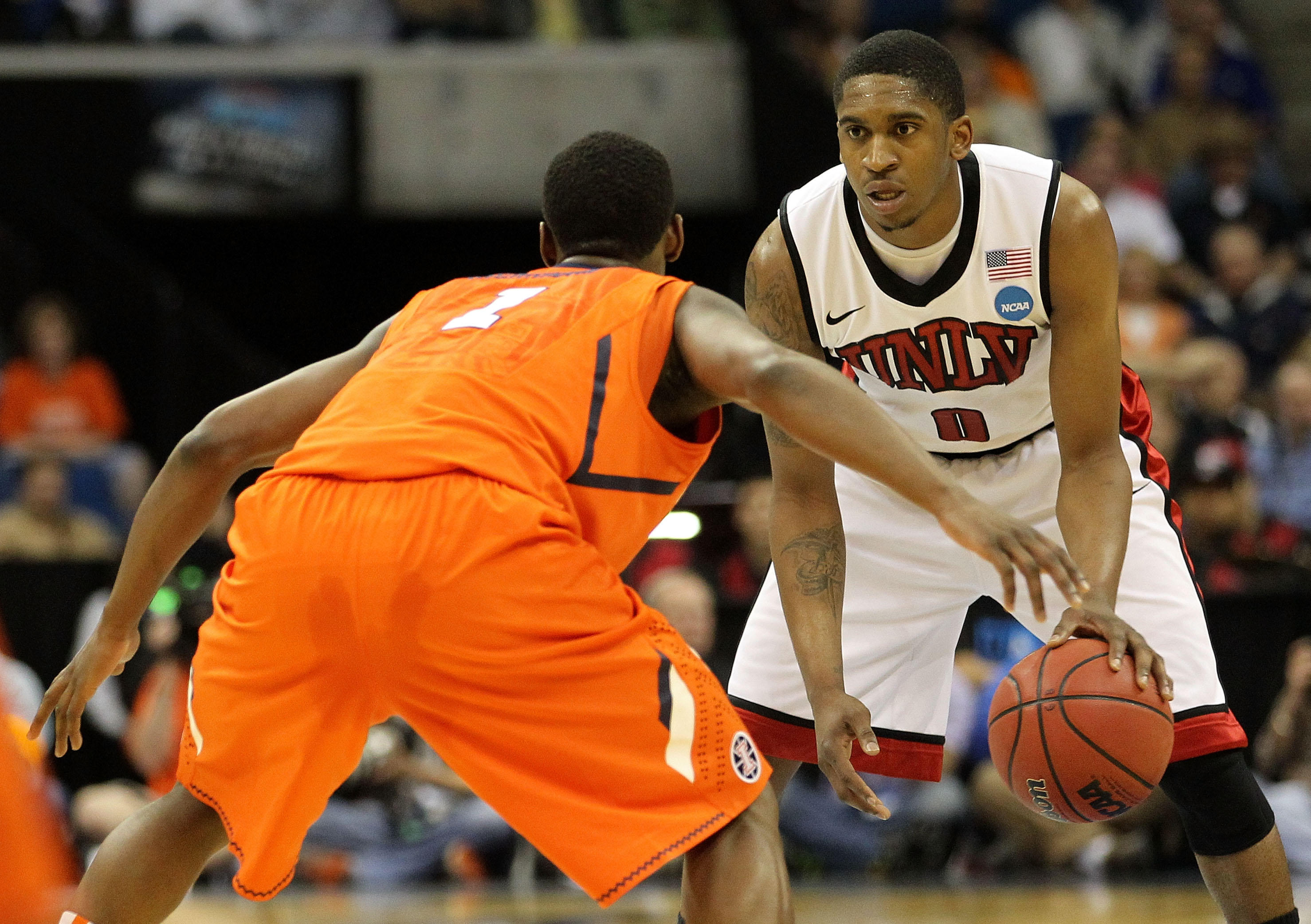 TULSA, OK - MARCH 18:  Oscar Bellfield #0 of the UNLV Rebels looks to move the ball as D.J. Richardson #1 of the Illinois Fighting Illini defends during the second round of the 2011 NCAA men's basketball tournament at BOK Center on March 18, 2011 in Tulsa