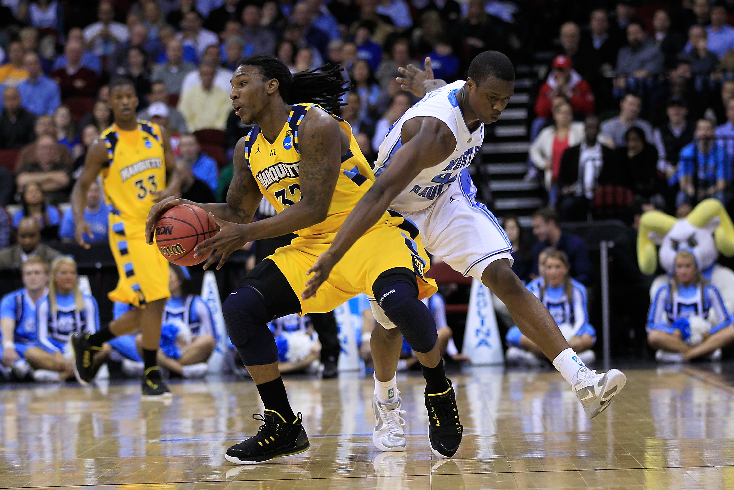 NEWARK, NJ - MARCH 25:  Jae Crowder #32 of the Marquette Golden Eagles in action against the North Carolina Tar Heels during the east regional semifinal of the 2011 NCAA Men's Basketball Tournament at the Prudential Center on March 25, 2011 in Newark, New