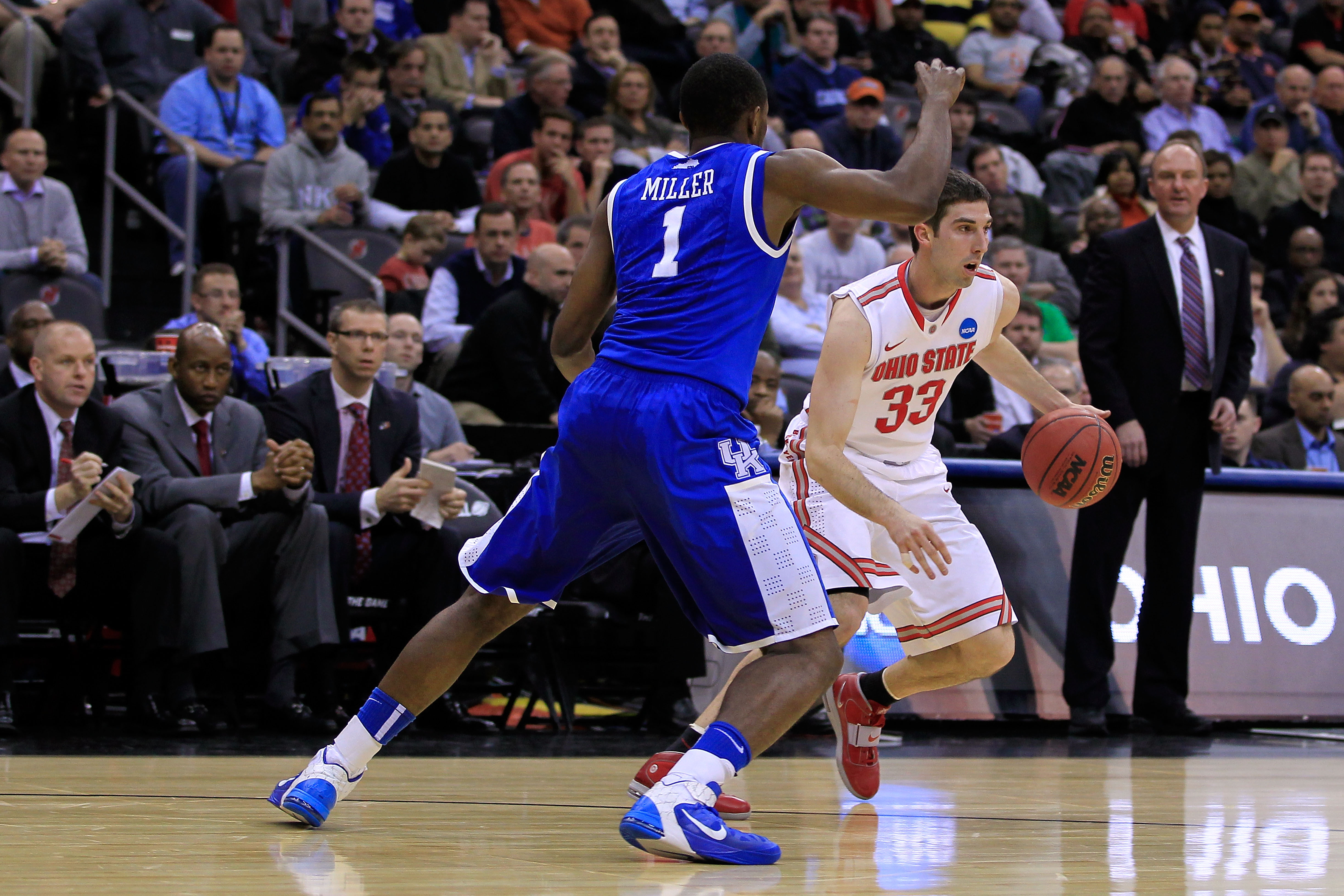 NEWARK, NJ - MARCH 25:  Jon Diebler #33 of the Ohio State Buckeyes in action against Darius Miller #1 of the Kentucky Wildcats during the east regional semifinal of the 2011 NCAA Men's Basketball Tournament at the Prudential Center on March 25, 2011 in Ne