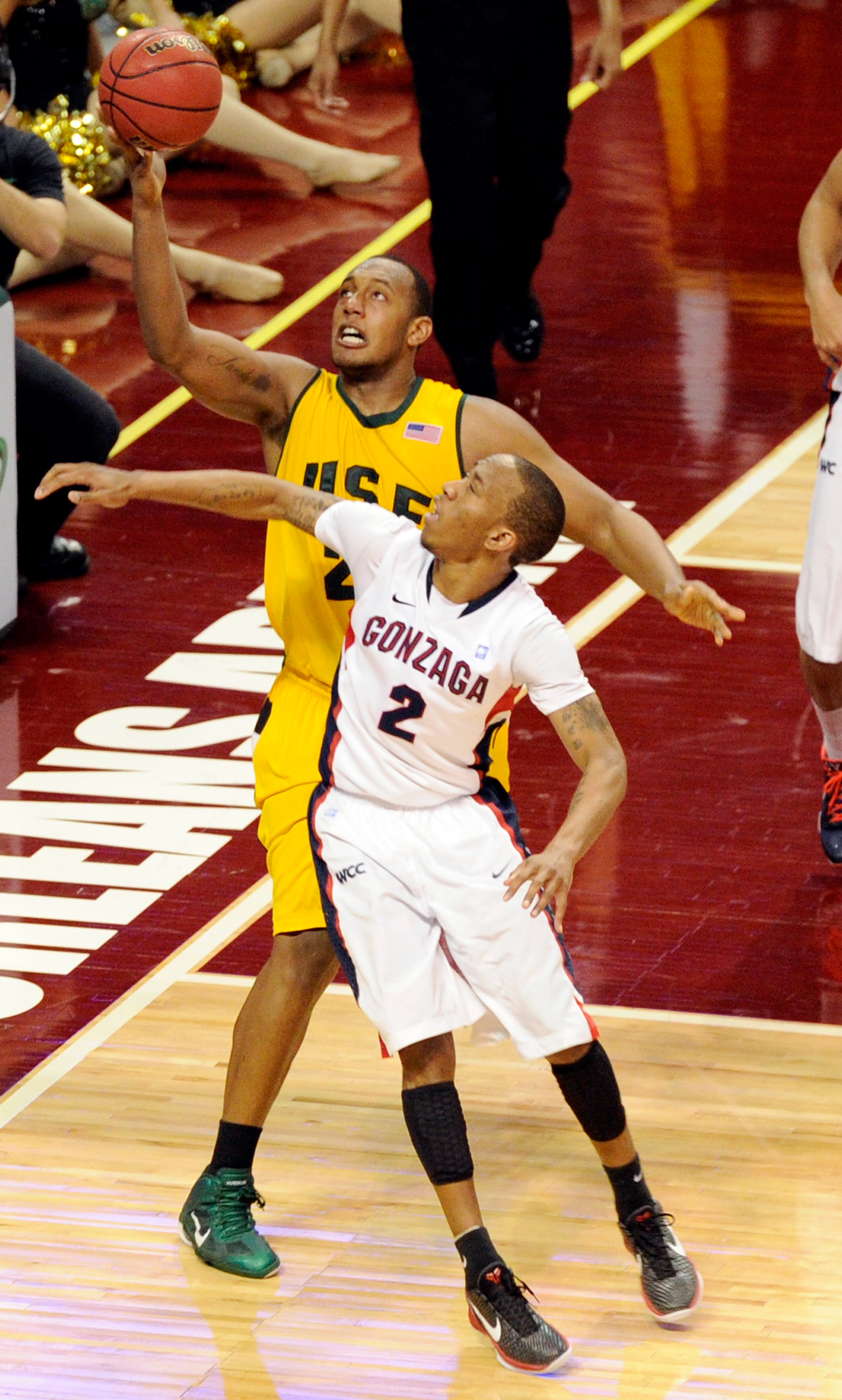 LAS VEGAS, NV - MARCH 06:  Perris Blackwell #22 of the San Francisco Dons grabs a rebound over Marquise Carter #2 of the Gonzaga Bulldogs during a semifinal game of the Zappos.com West Coast Conference Basketball tournament at the Orleans Arena March 6, 2