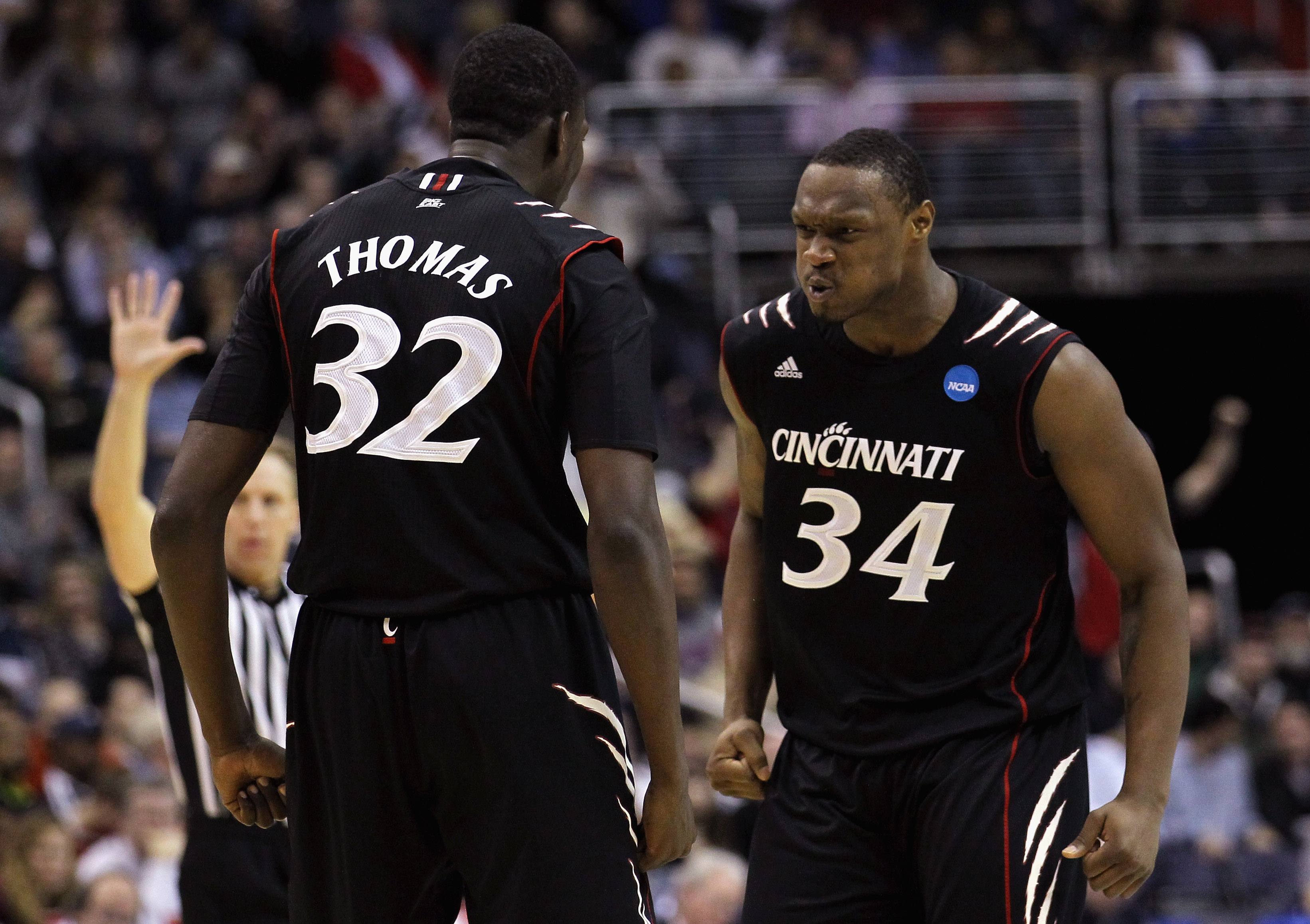 WASHINGTON - MARCH 19:  Ibrahima Thomas #32 of Cincinnati celebrates with teammate Yancy Gates #34 against Connecticut during the third round of the 2011 NCAA men's basketball tournament at Verizon Center on March 19, 2011 in Washington, DC.  (Photo by Ni