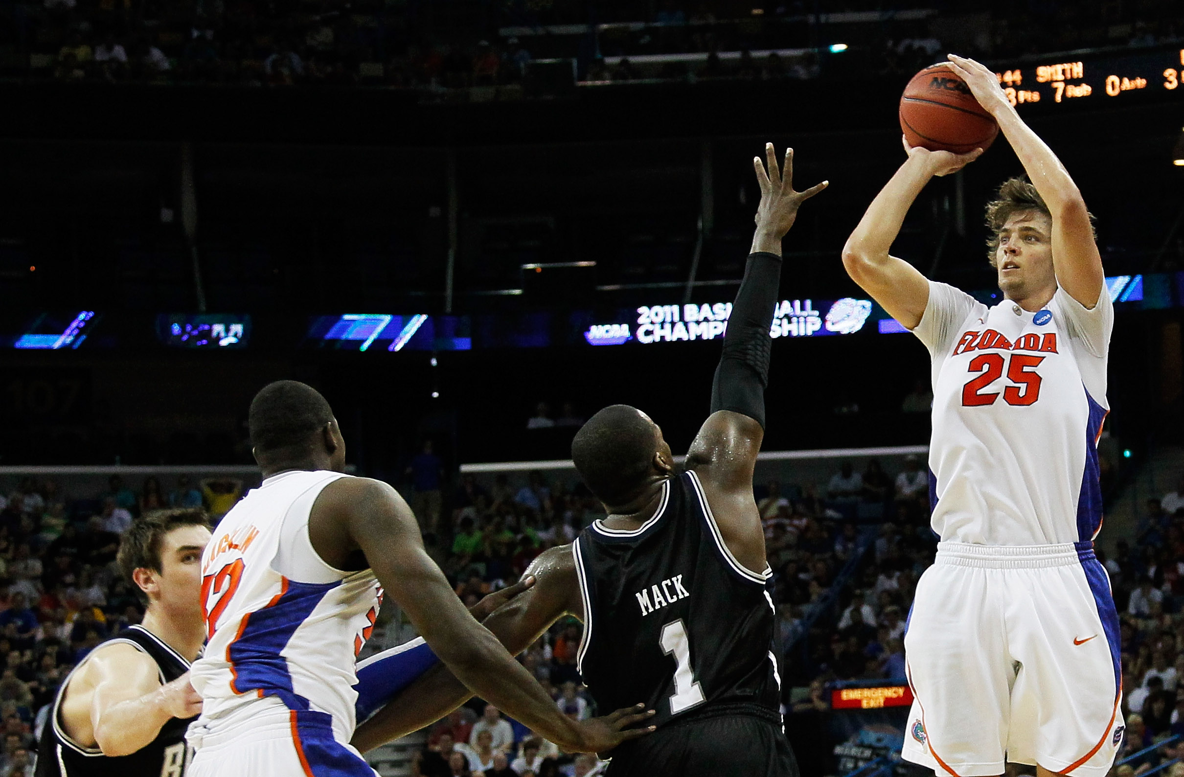 NEW ORLEANS, LA - MARCH 26:  Chandler Parsons #25 of the Florida Gators shoots over Shelvin Mack #1 of the Butler Bulldogs during the Southeast regional final of the 2011 NCAA men's basketball tournament at New Orleans Arena on March 26, 2011 in New Orlea