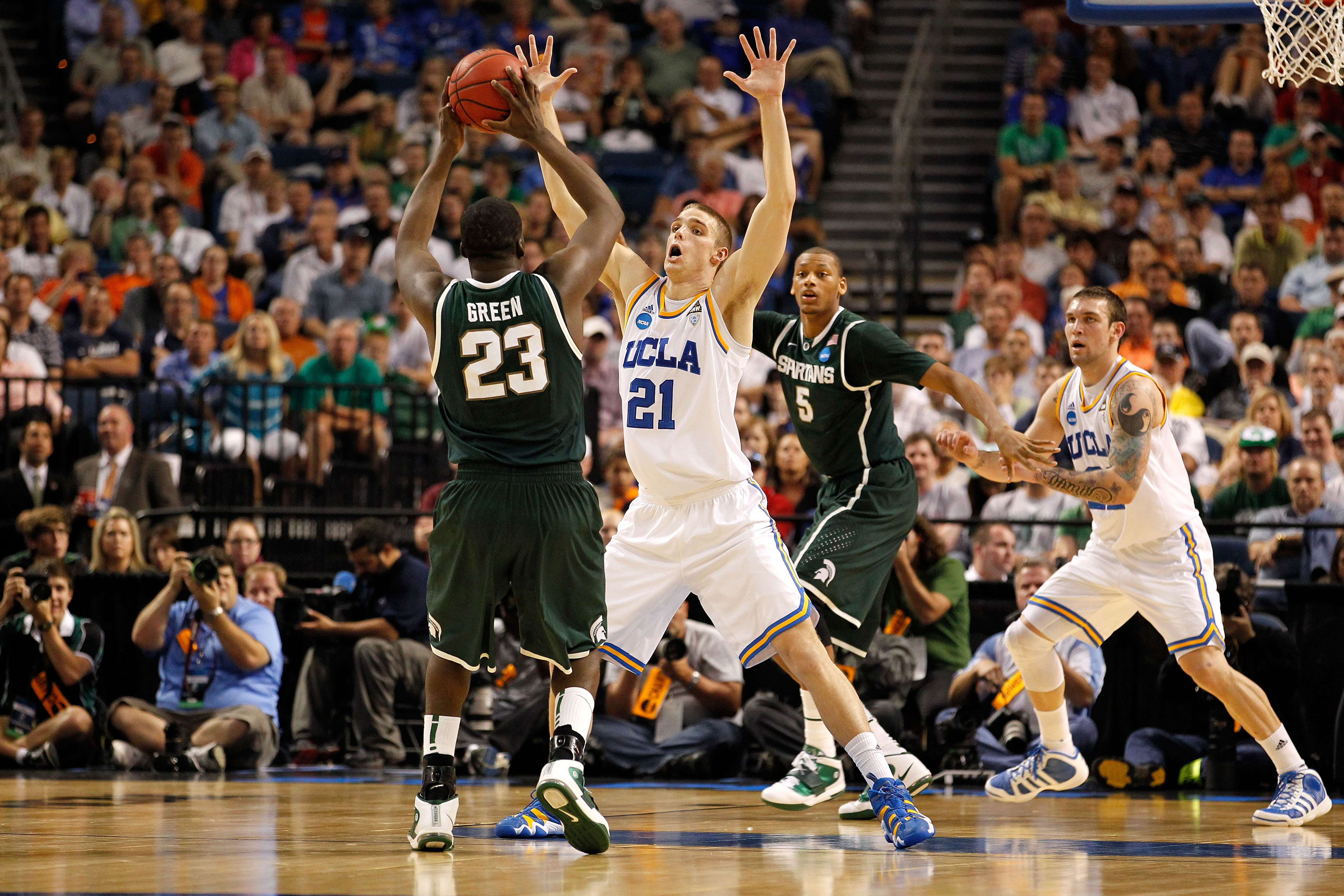 TAMPA, FL - MARCH 17:  Brendan Lane #21 of the UCLA Bruins defends against Draymond Green #23 of the Michigan State Spartans during the second round of the 2011 NCAA men's basketball tournament at St. Pete Times Forum on March 17, 2011 in Tampa, Florida.