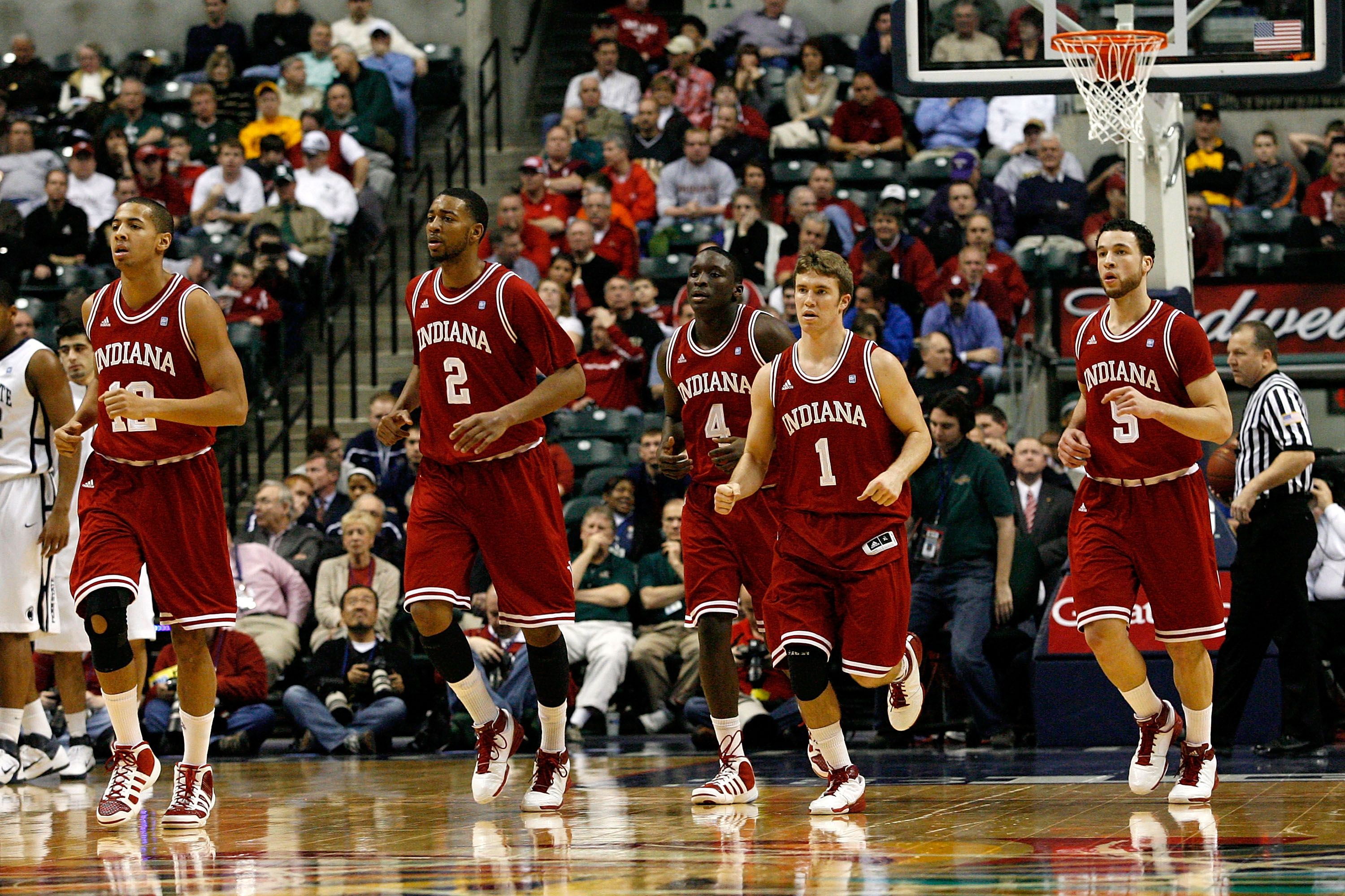INDIANAPOLIS, IN - MARCH 10:  (L-R) Verdell Jones III #12, Christian Watford #2, Victor Oladipo #4, Jordan Hulls #1 and Jeremiah Rivers #5 of the Indiana Hoosiers run towards the bench for a timeout against the Penn State Nittany Lions during the first ro