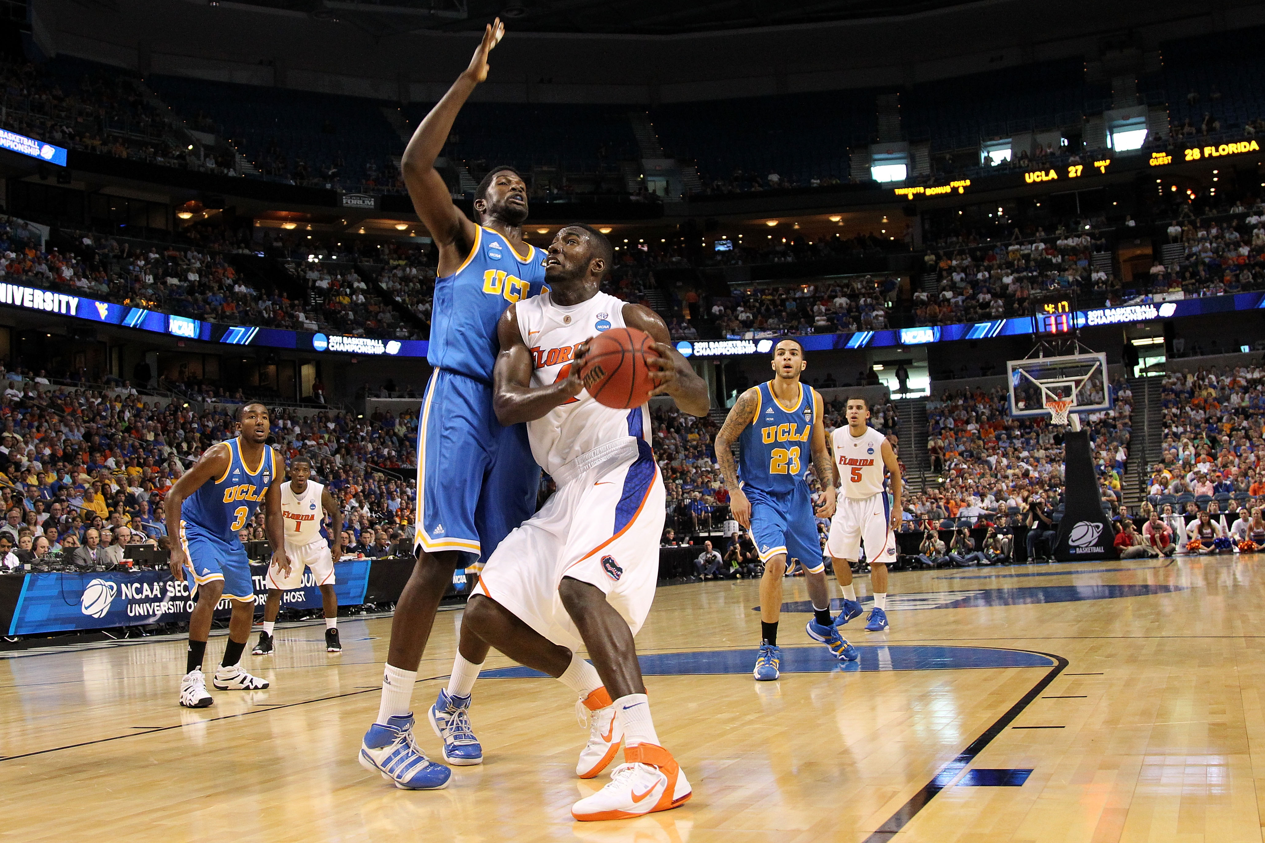 TAMPA, FL - MARCH 19:  Patric Young #4 of the Florida Gators drives against Anthony Stover #0 of the UCLA Bruins during the third round of the 2011 NCAA men's basketball tournament at St. Pete Times Forum on March 19, 2011 in Tampa, Florida. Florida won 7
