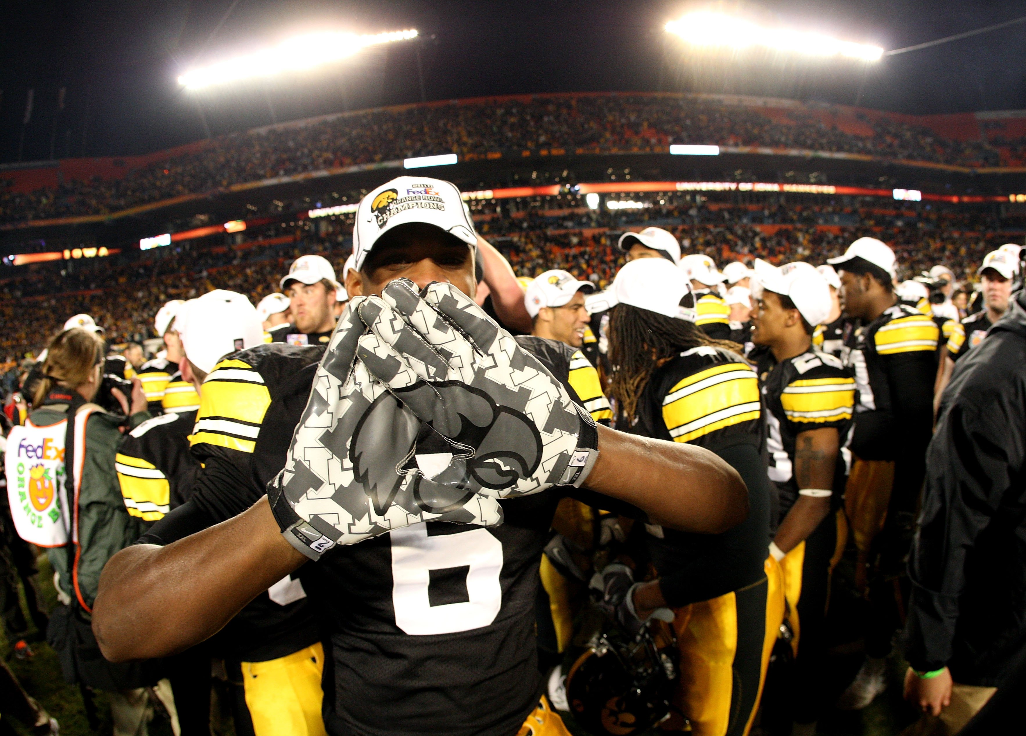 MIAMI GARDENS, FL - JANUARY 05:  Keenan Davis #6 of the Iowa Hawkeyes celebrates after Iowa won 24-14 against the Georgia Tech Yellow Jackets during the FedEx Orange Bowl at Land Shark Stadium on January 5, 2010 in Miami Gardens, Florida.  (Photo by Stree