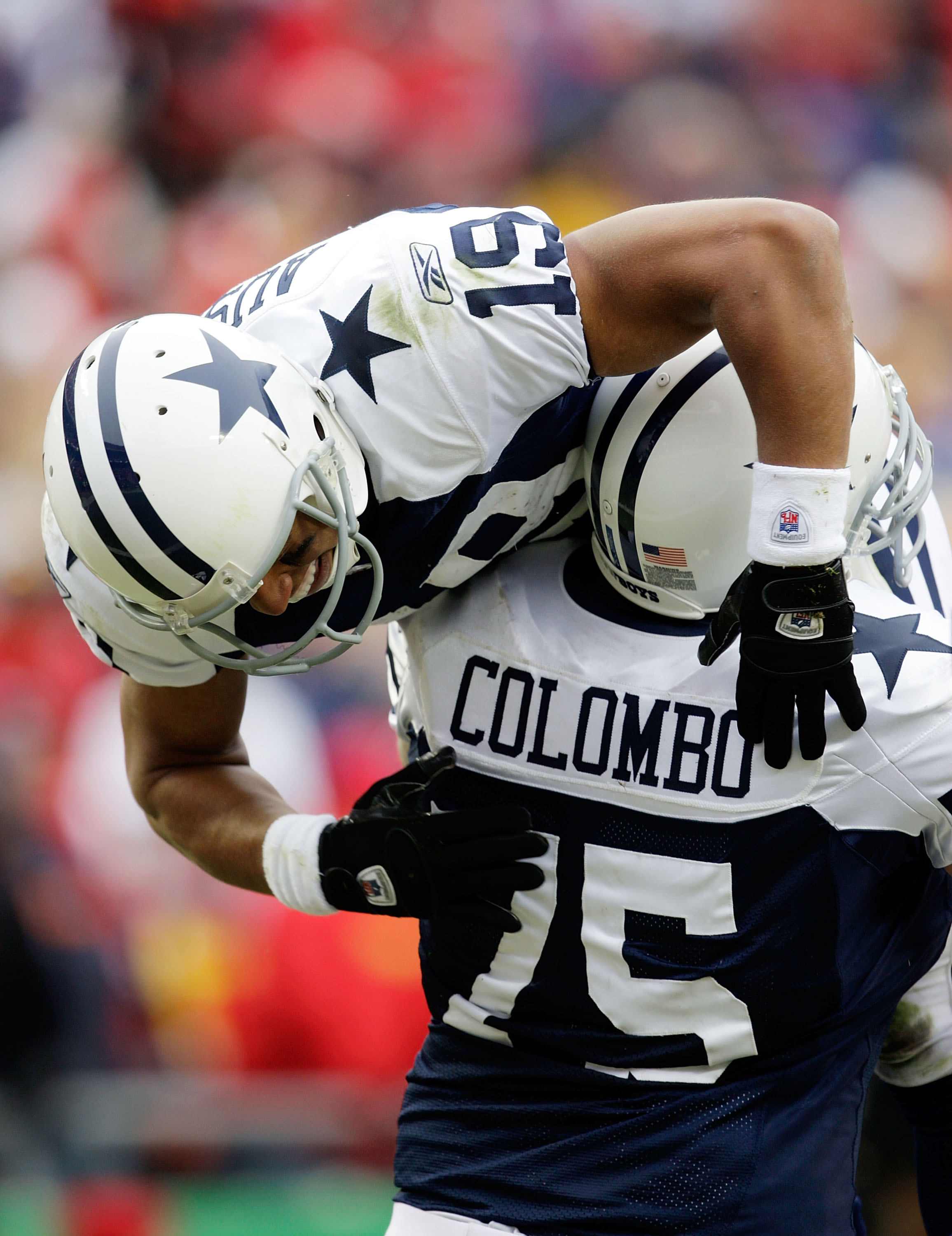 KANSAS CITY, MO - OCTOBER 11:  Miles Austin #19 of the Dallas Cowboys celebrates a touchdown as he is lifted up by Marc Columbo #75 during the game against the Kansas City Chiefs on October 11, 2009 at Arrowhead Stadiumin Kansas City, Missouri.  (Photo by